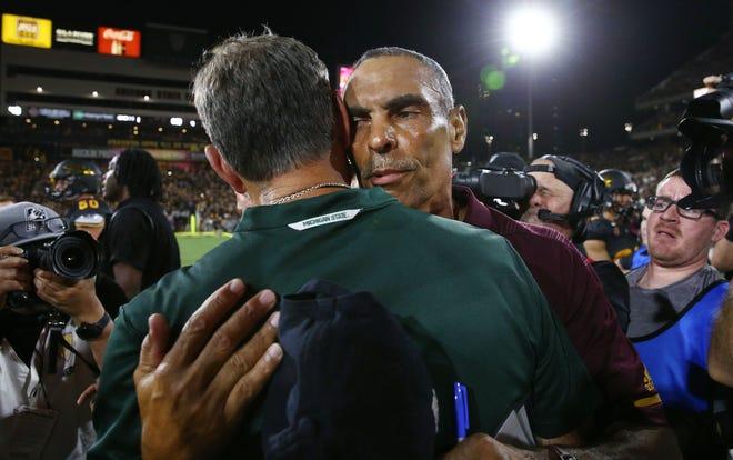 Arizona State head coach Herm Edwards hugs Michigan State head coach Mark Dantonio after the Sun Devils defeated Spartans 16-13 on Sep. 8, 2018, at Sun Devil Stadium.