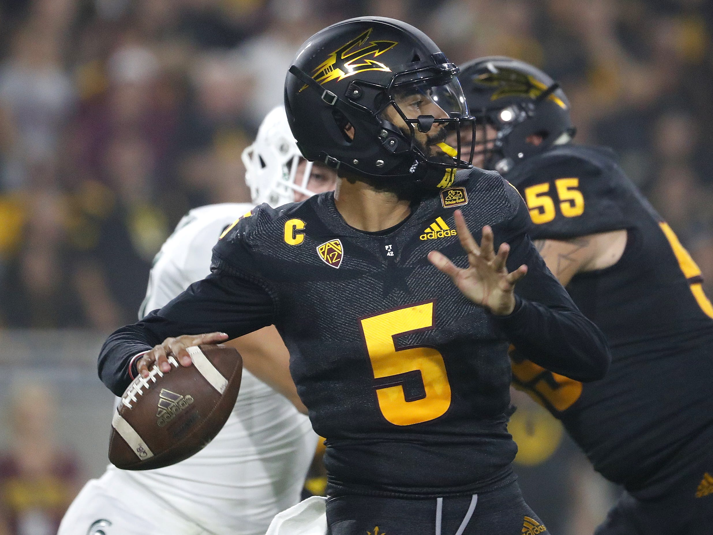 Arizona State Sun Devils quarterback Manny Wilkins (5) throws a pass under pressure from Michigan State's Justice Alexander (97) during the second quarter at Sun Devil Stadium in Tempe, Ariz. on Sept. 8, 2018.