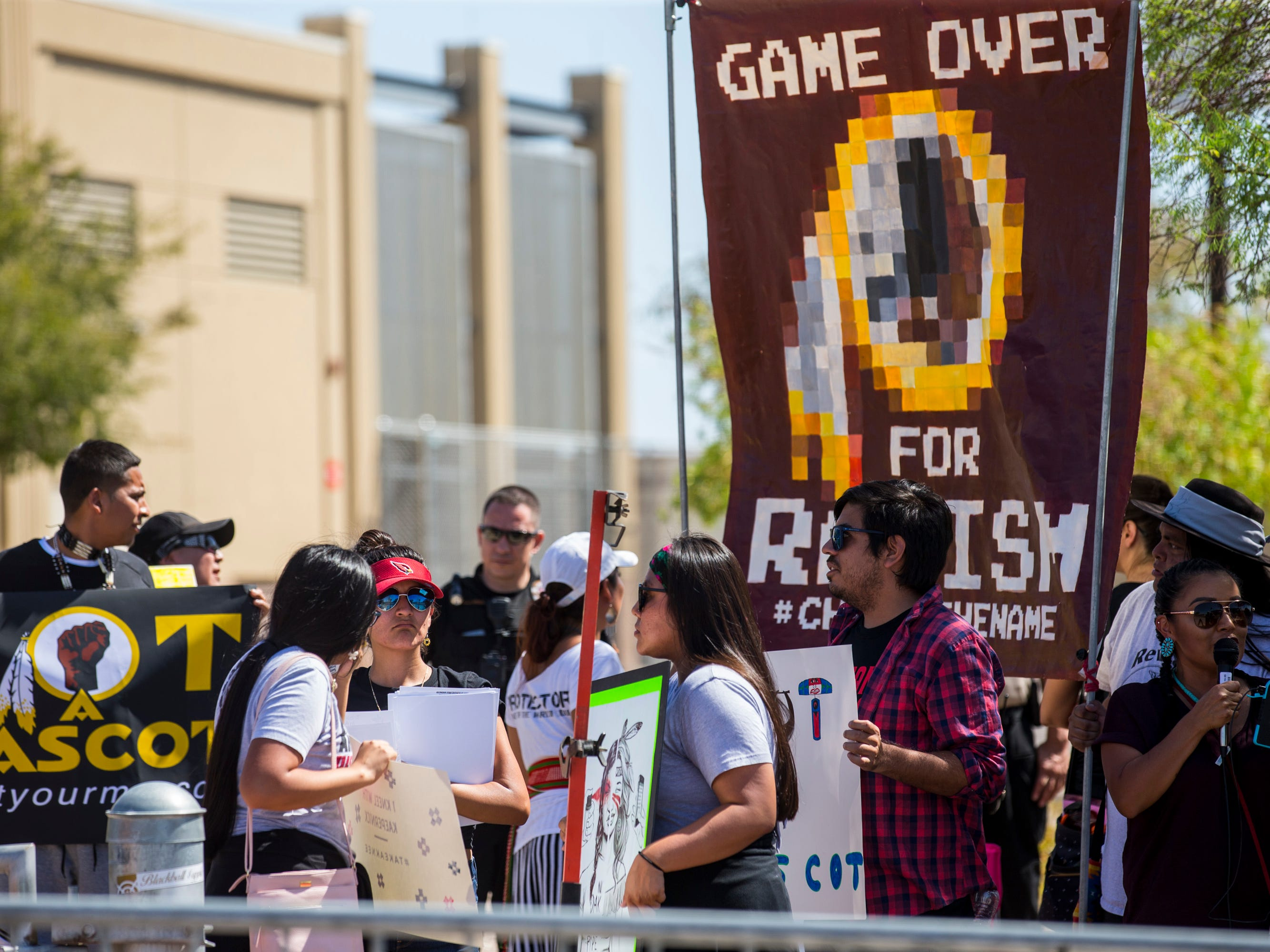 People protest against Washington's mascot before the Cardinals game against the Redskins on Sept. 9, 2018, at State Farm Stadium in Glendale.
