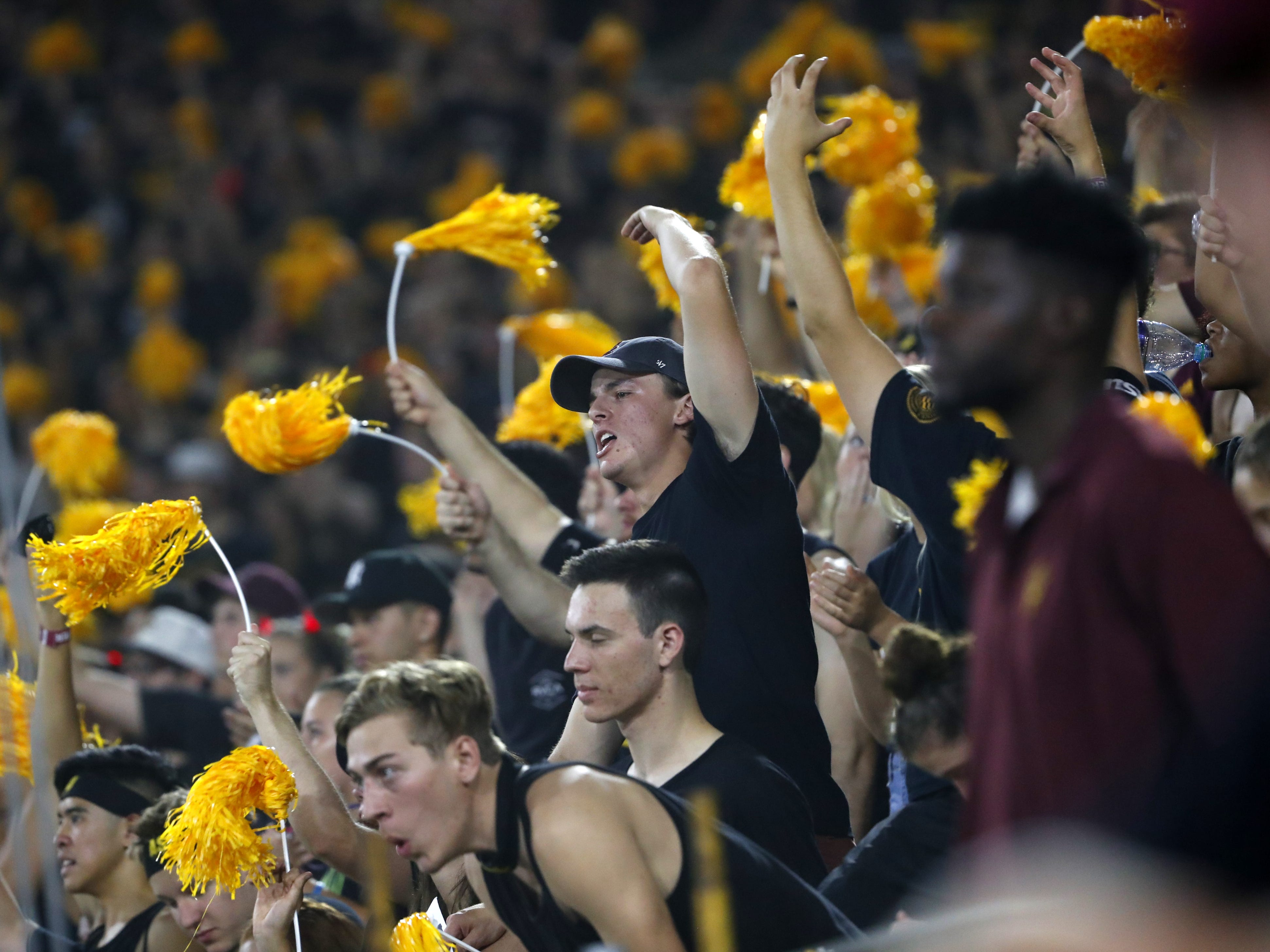 ASU fans cheer on their team during the third quarter at Sun Devil Stadium in Tempe, Ariz. on Sept. 8, 2018.