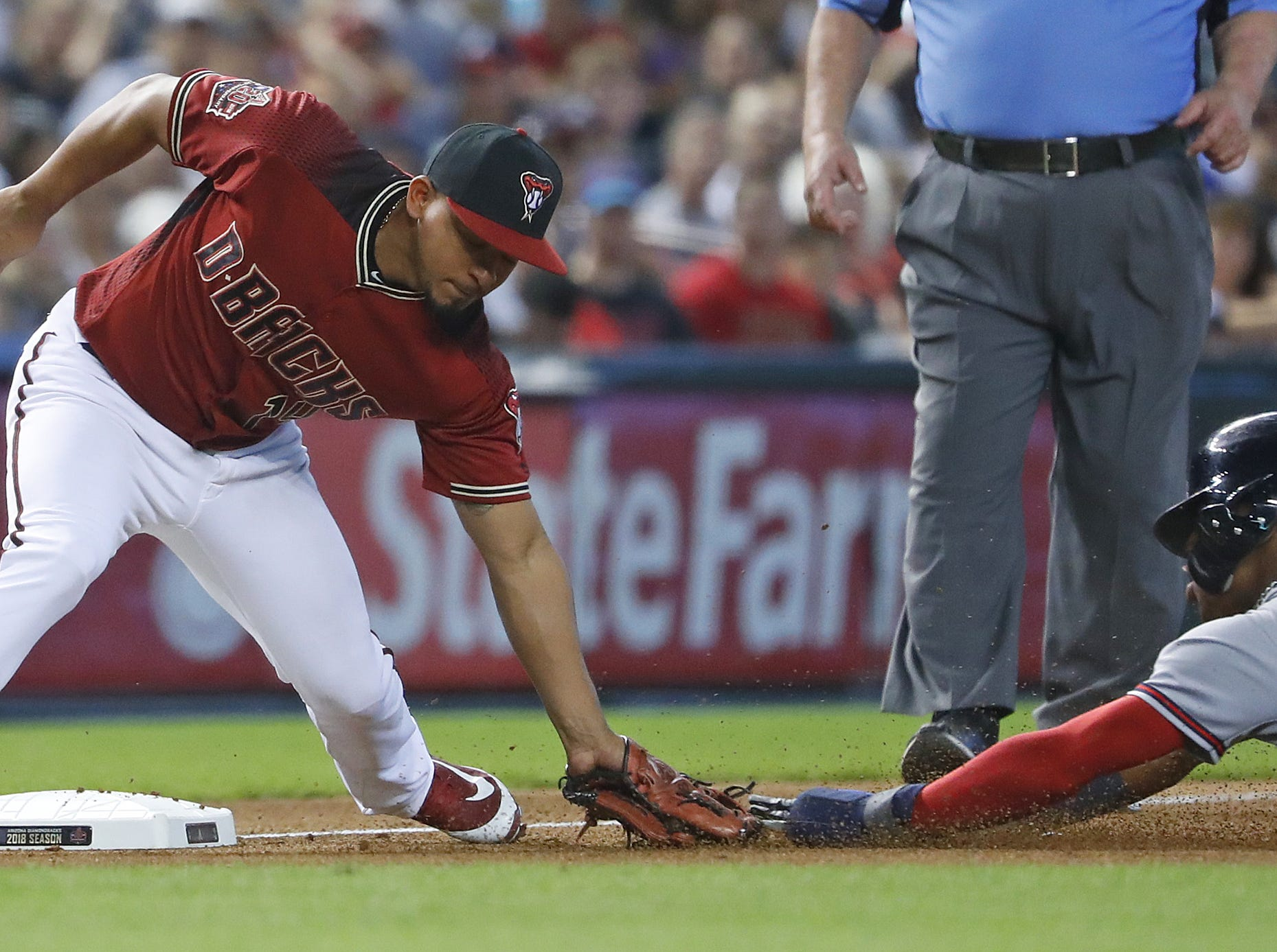 Diamondbacks Eduardo Escobar (14) tags out Braves Ronald Acuna (13) as he attempted to steal third base during the fourth inning at Chase Field in Phoenix, Ariz. on Sept. 9, 2018.