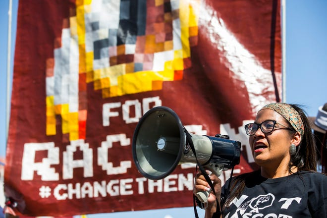 Jennifer Touchine protests against Washington's mascot before the Cardinals game against the Redskins, Sept. 9, 2018, at State Farm Stadium in Glendale.