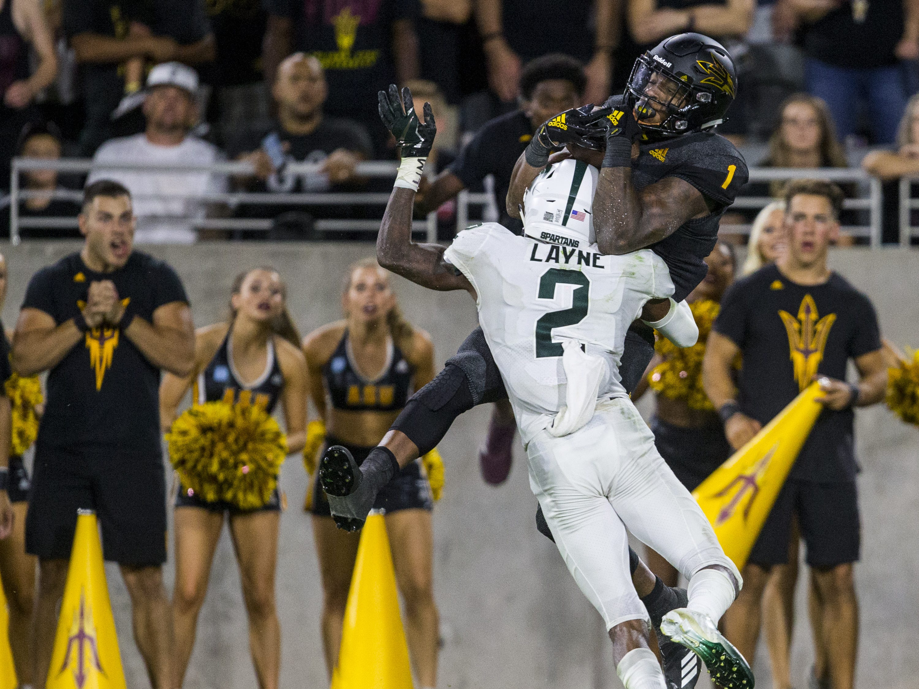 Arizona State's N'Keal Harry makes a catch over Michigan State's Justin Layne for a touchdown in the 4th quarter on Saturday, Sept. 8, 2018, at Sun Devil Stadium in Tempe, Ariz. Arizona State won, 16-13.