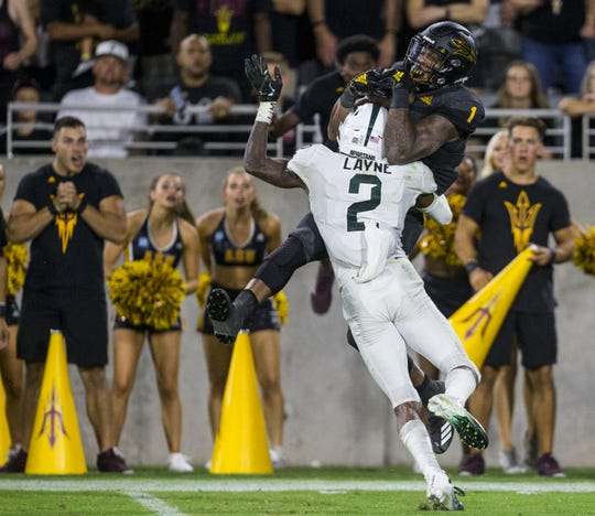 N'Keal Harry makes a catch over Justin Layne for a touchdown in the fourth quarter.