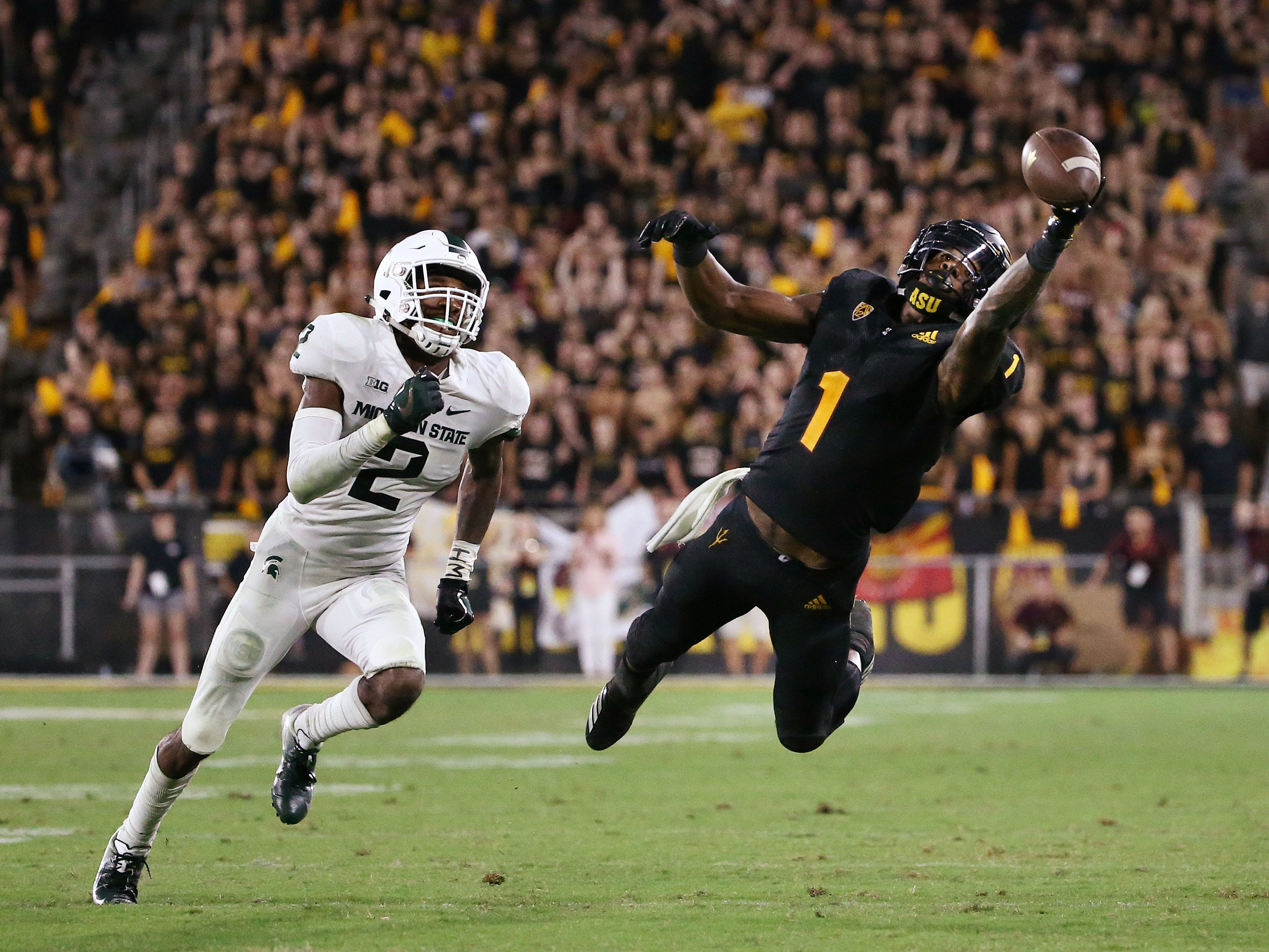 Arizona State wide receiver N'Keal Harry dives for the ball against Michigan State in the second half on Sep. 8, 2018, at Sun Devil Stadium.