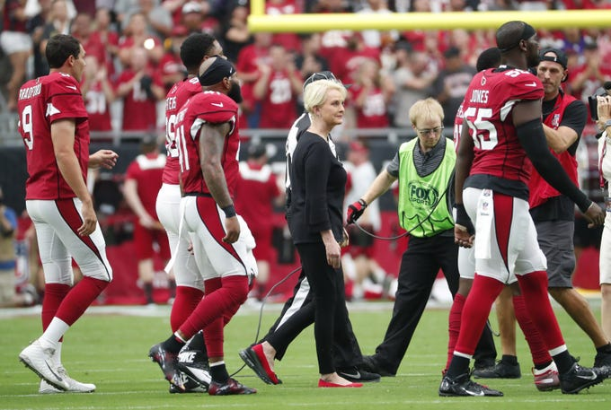 Cindy McCain walks out as an honorary Arizona Cardinals captain for the coin toss with the Washington Redskins at State Farm Stadium in Glendale, Ariz. September 9. 2018.