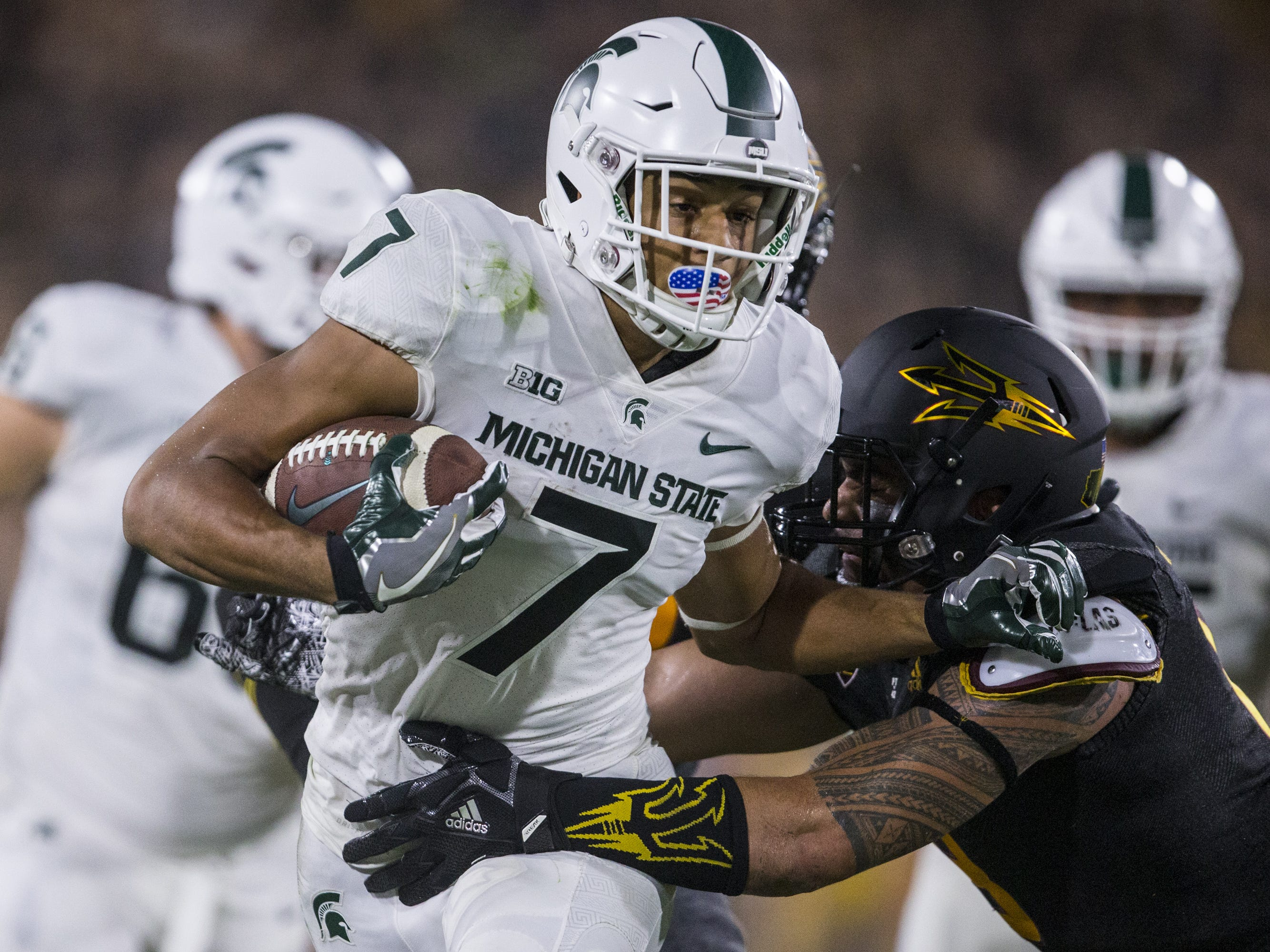 Michigan State's Cody White runs after a catch against Arizona State in the 3rd quarter on Saturday, Sept. 8, 2018, at Sun Devil Stadium in Tempe, Ariz.
