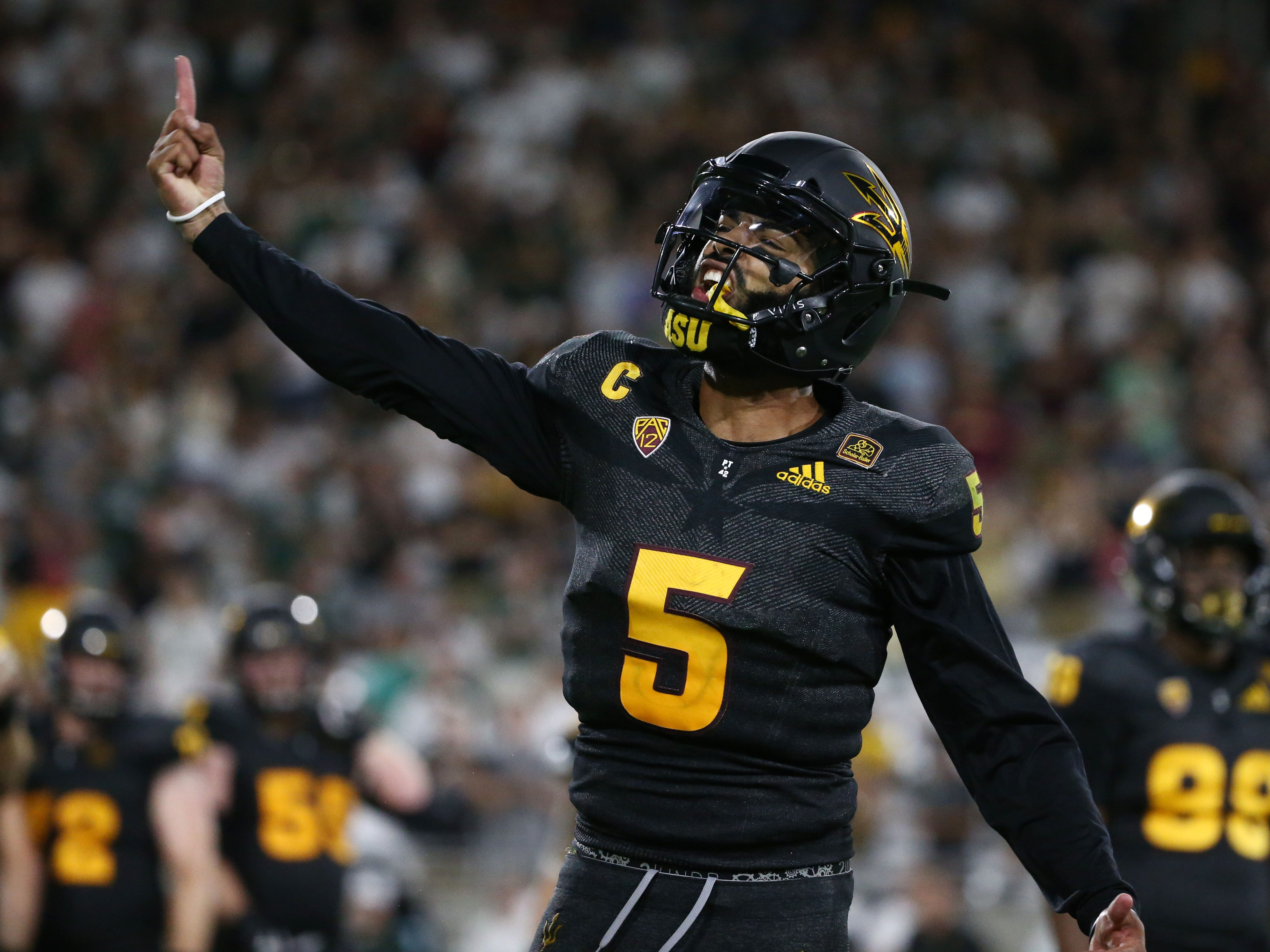 Arizona State quarterback Manny Wilkins reacts as the Devils prepares to kick the game winning field goal against Michigan State in the second half on Sep. 8, 2018, at Sun Devil Stadium.