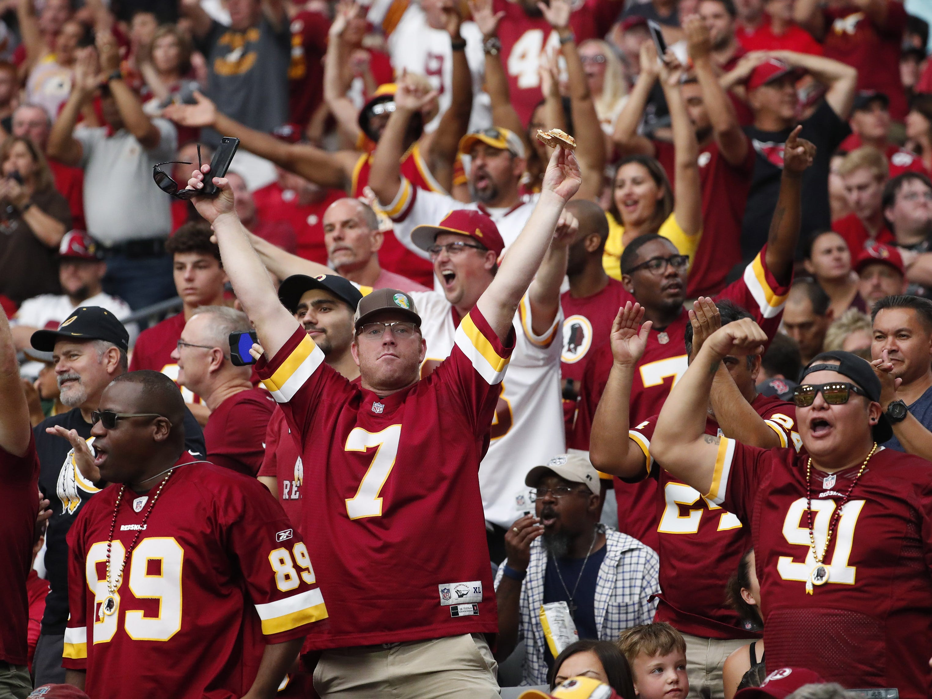Washington Redskins fans cheer during the second quarter against the Arizona Cardinals at State Farm Stadium in Glendale, Ariz. September 9. 2018.