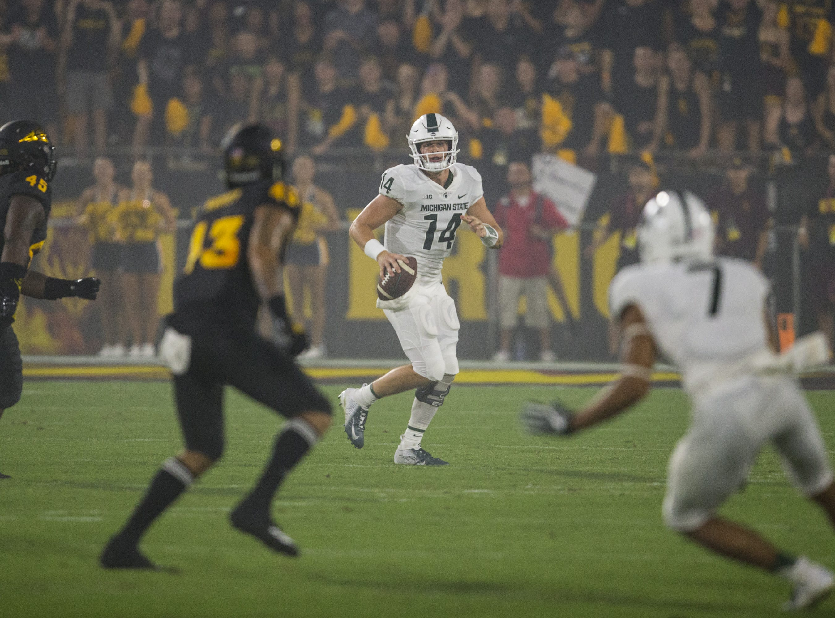 Michigan State's Brian Lewerke looks to pass against Arizona State in the 1st quarter on Saturday, Sept. 8, 2018, at Sun Devil Stadium in Tempe, Ariz.