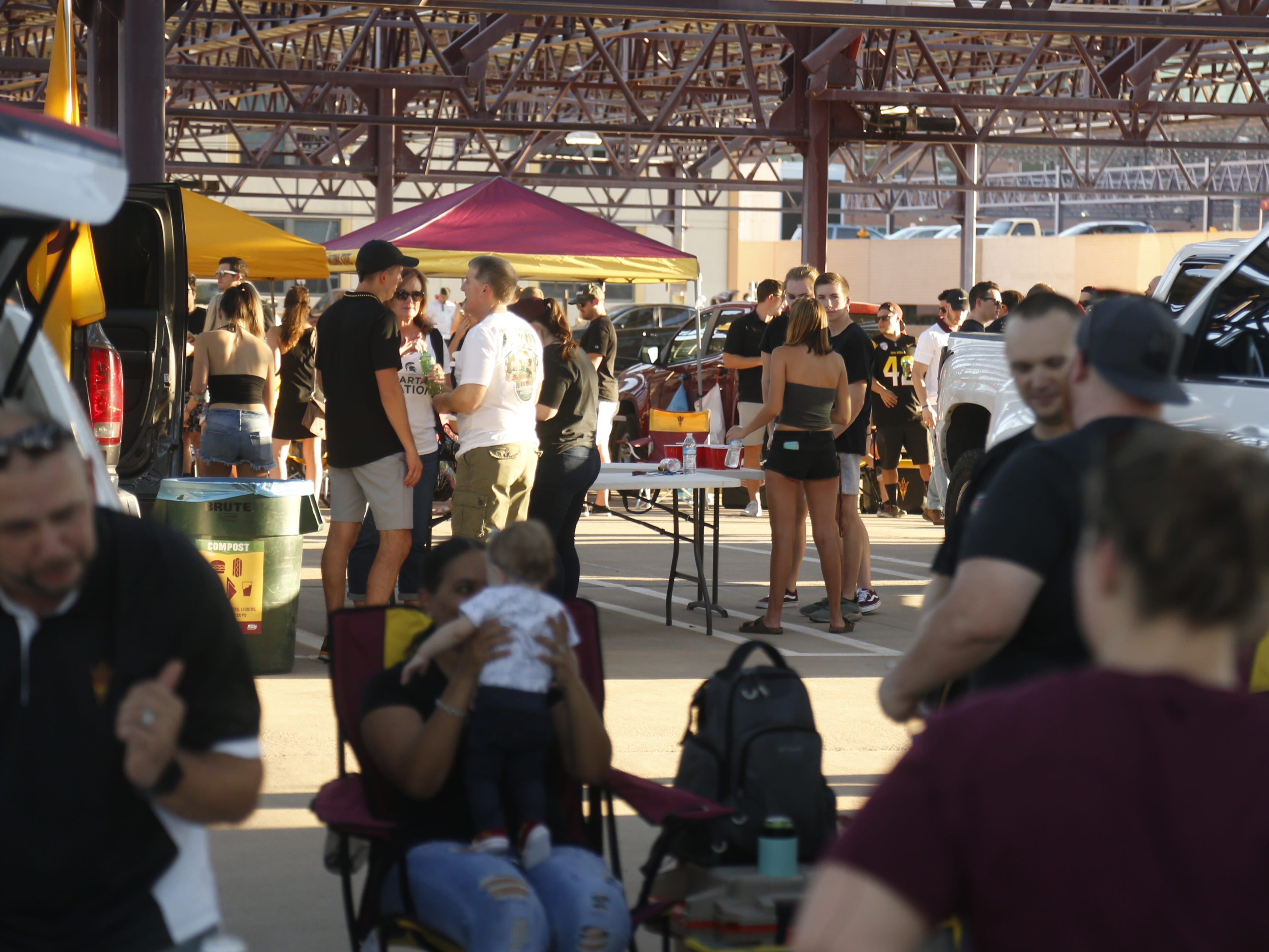 ASU fans take over the top of the Stadium Structure parking garage before an ASU game against Michigan State at Sun Devil Stadium in Tempe, Ariz. on Sept. 8, 2018.