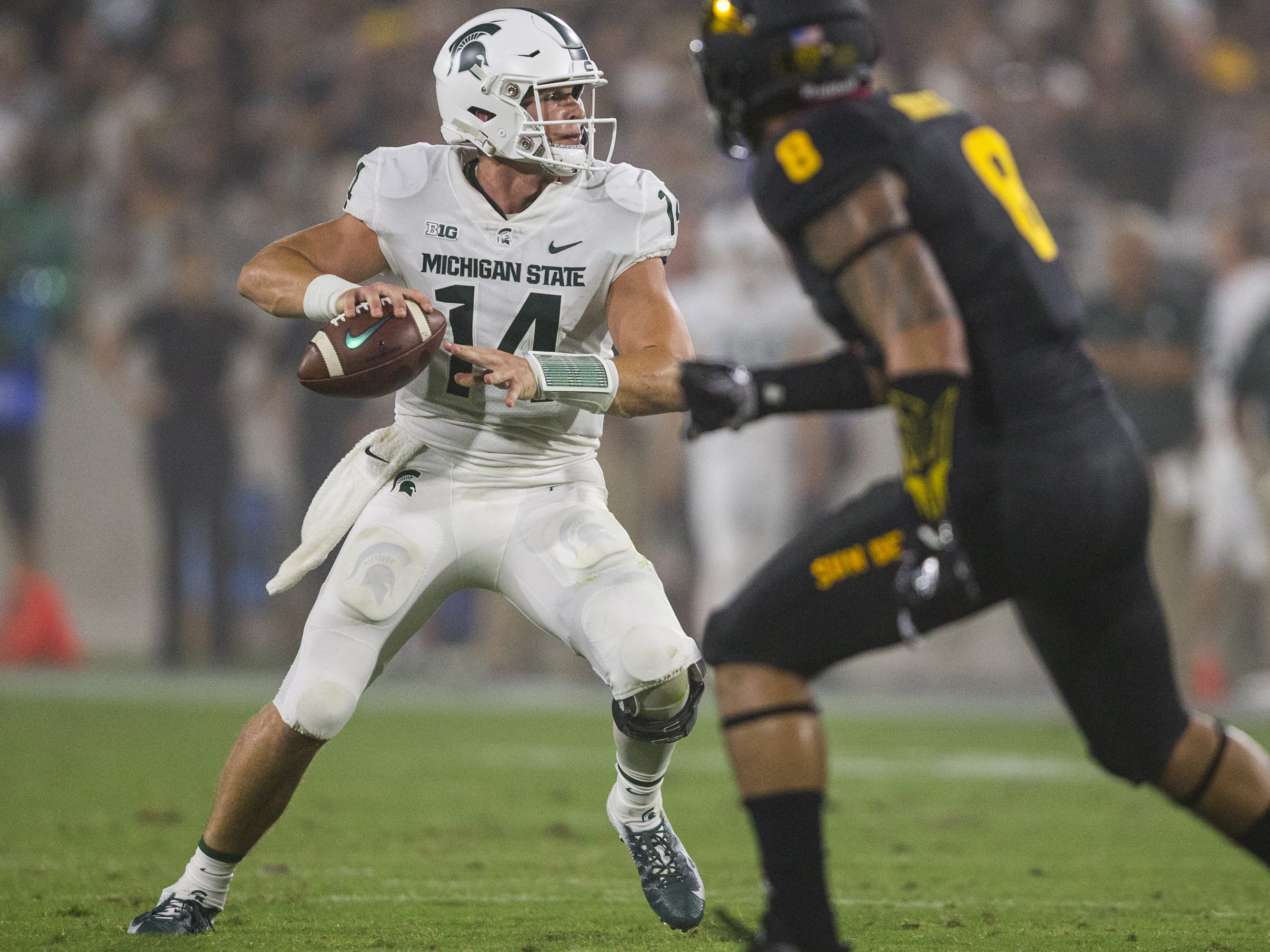 Michigan State's Brian Lewerke throws against Arizona State in the 2nd quarter on Saturday, Sept. 8, 2018, at Sun Devil Stadium in Tempe, Ariz.