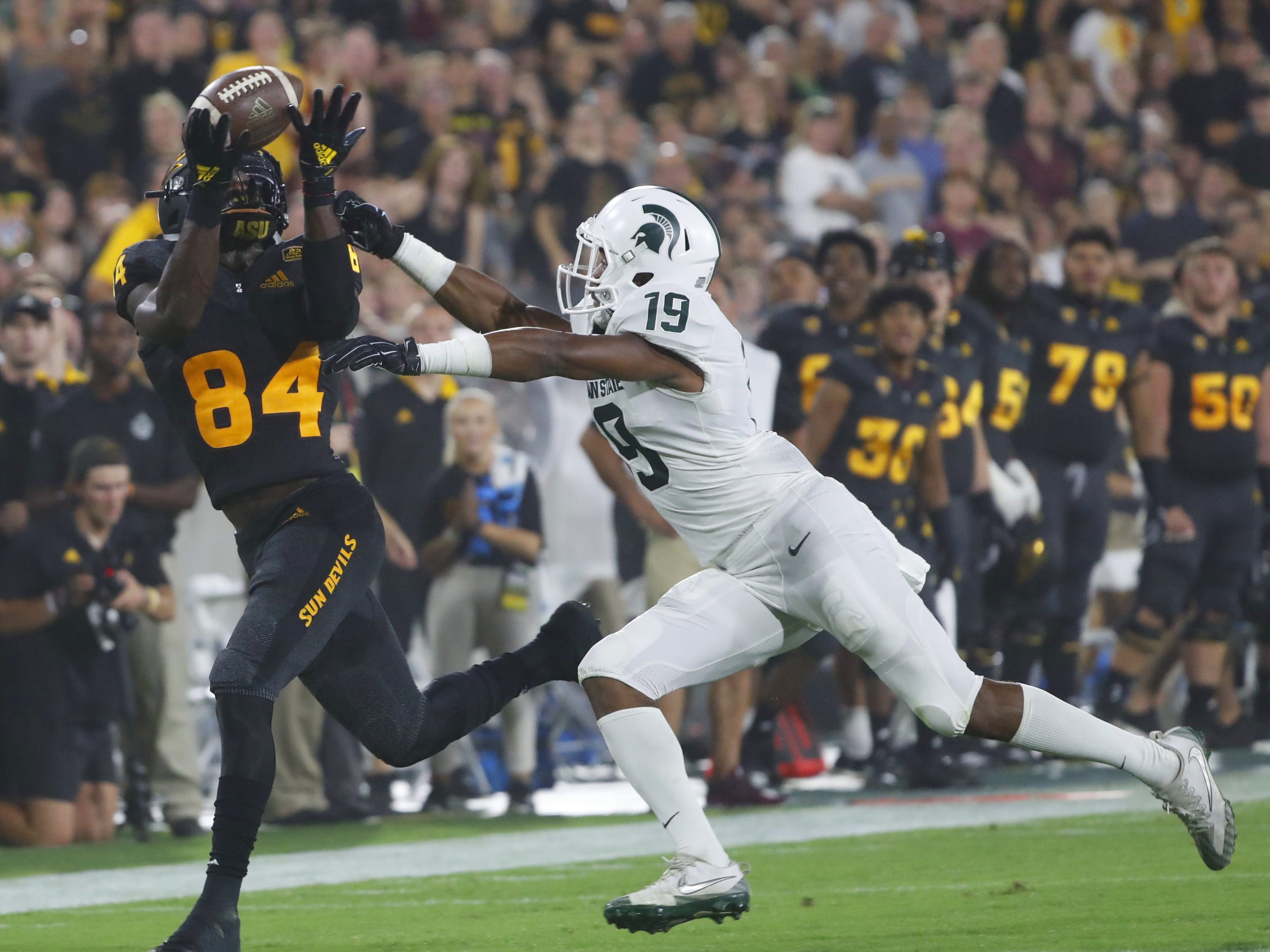 Arizona State Sun Devils wide receiver Frank Darby (84) tries to make a catch against Michigan State's Josh Butler (19) during the third quarter at Sun Devil Stadium in Tempe, Ariz. on Sept. 8, 2018.