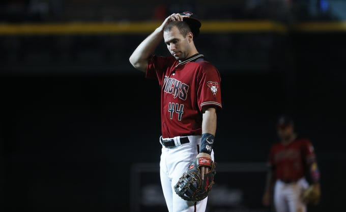 Diamondbacks Paul Goldschmidt (44) reacts after closer Brad Boxberger gave up a three-run home run to Braves Ender Inciarte (11) during the ninth inning at Chase Field in Phoenix, Ariz. on Sept. 9, 2018.