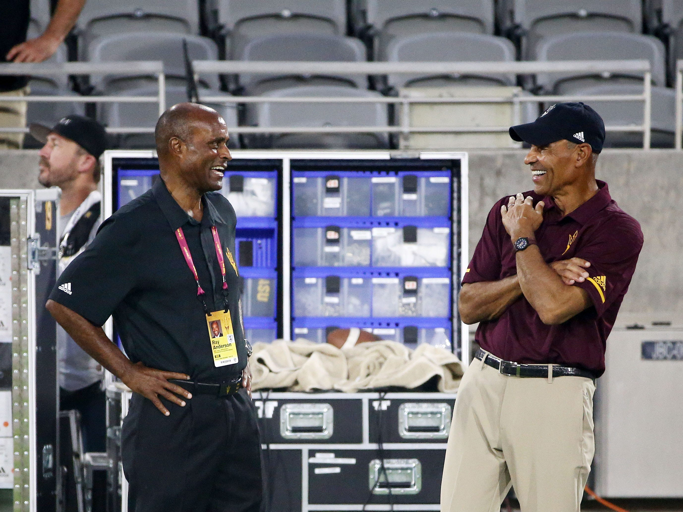 Arizona State AD Ray Anderson talks to head coach Herm Edwards during the pregame warm-up against Michigan State on Sep. 8, 2018, at Sun Devil Stadium.