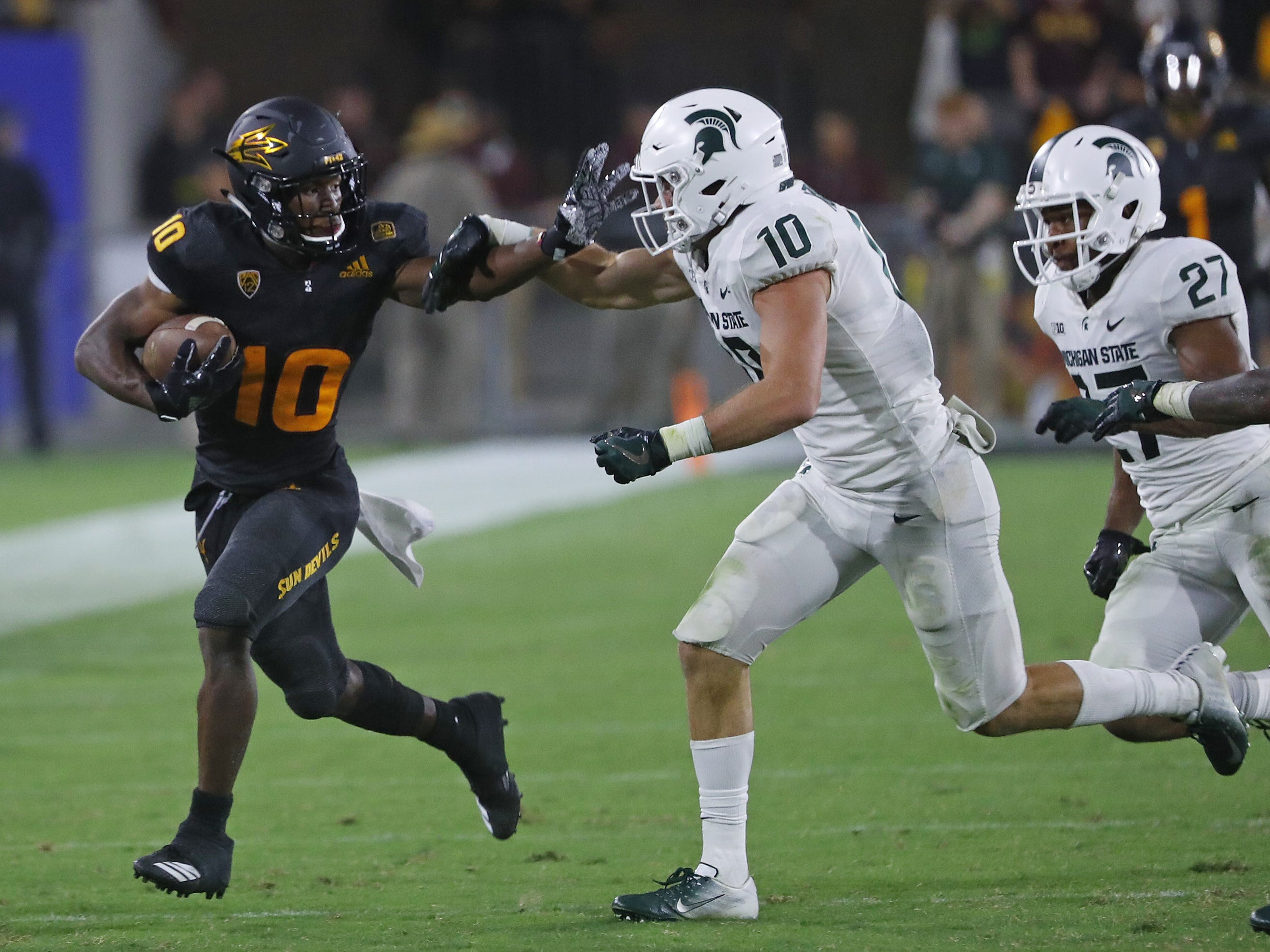 Arizona State Sun Devils wide receiver Kyle Williams (10) stiff arms Michigan State's Matt Morrissey (10) during the fourth quarter at Sun Devil Stadium in Tempe, Ariz. on Sept. 8, 2018.