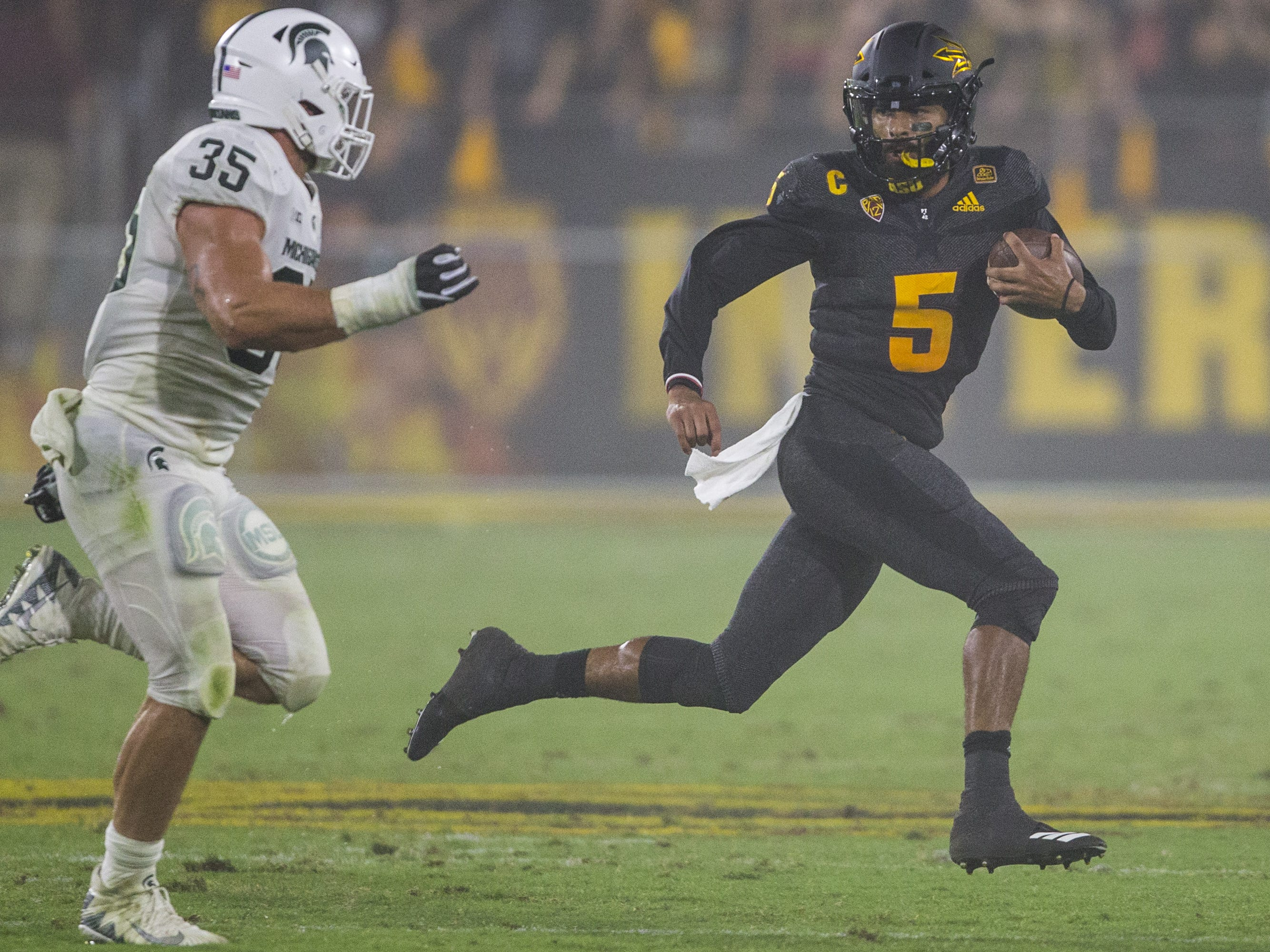Arizona State's Manny Wilkins rushes against Michigan State in the 2nd quarter on Saturday, Sept. 8, 2018, at Sun Devil Stadium in Tempe, Ariz.