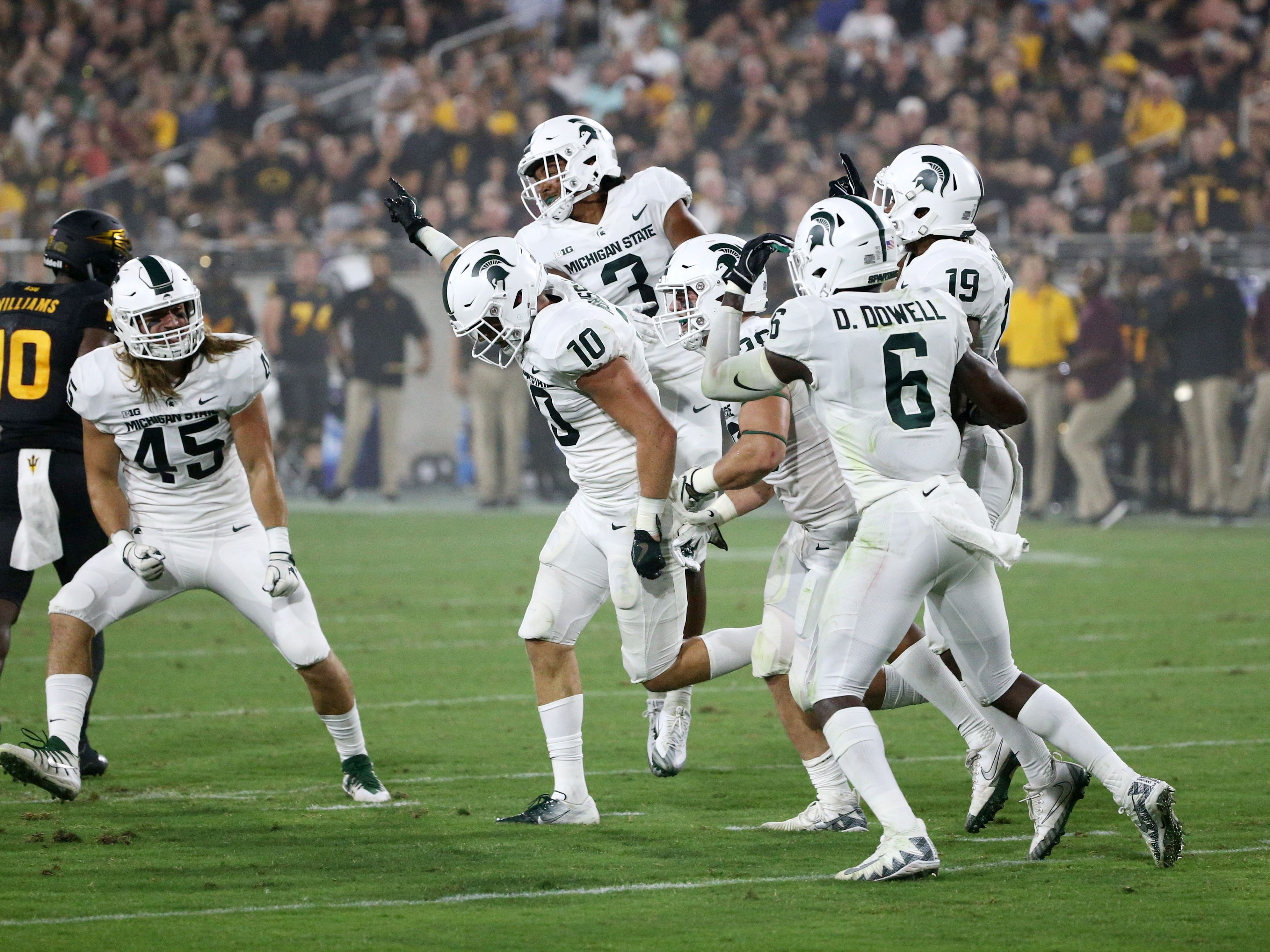 Michigan State safety Matt Morrissey (10) celebrates his interception against Arizona State in the first half on Sep. 8, 2018, at Sun Devil Stadium.