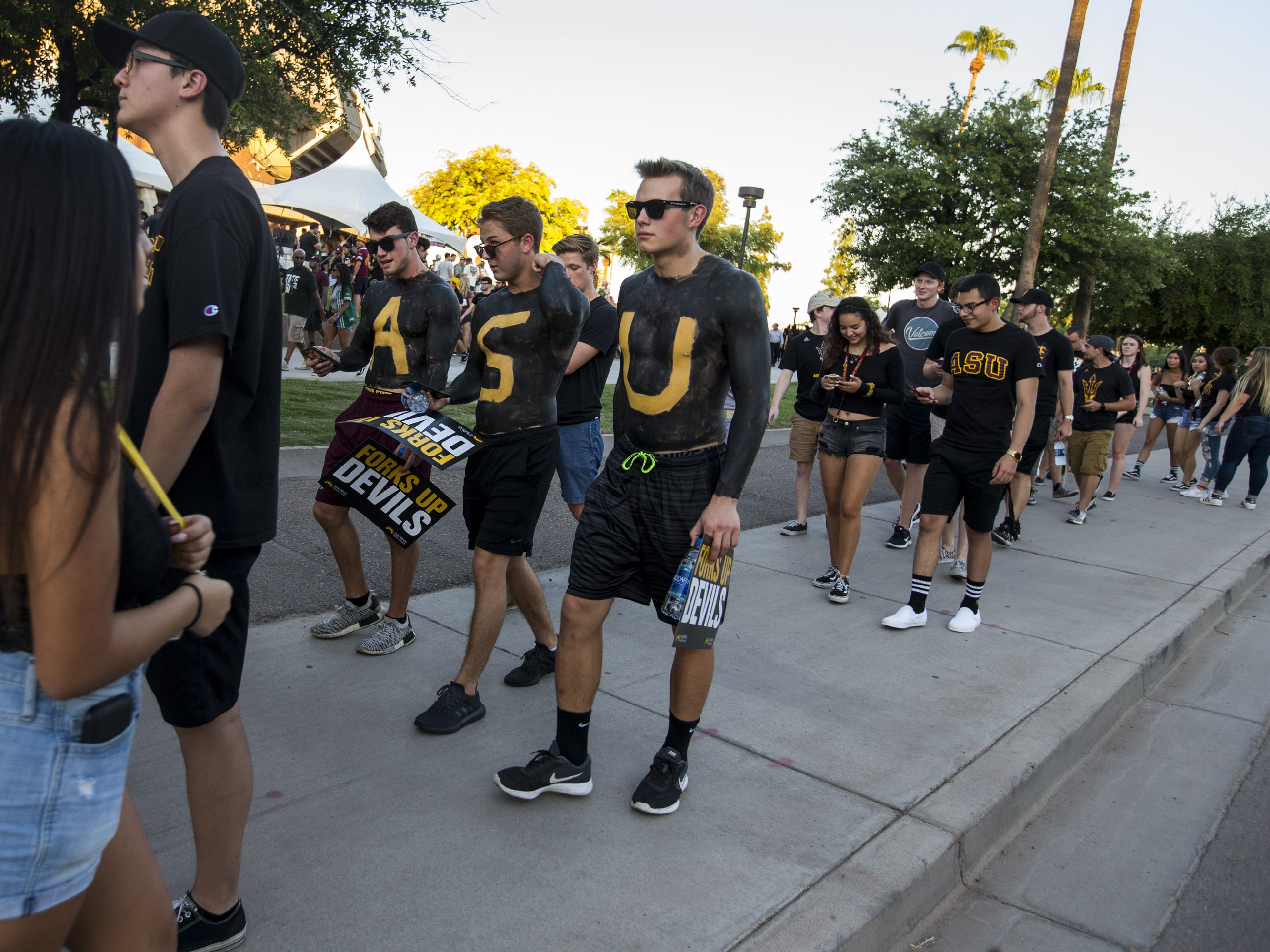 Fans wait in line before the game against Michigan State on Saturday, Sept. 8, 2018, at Sun Devil Stadium in Tempe, Ariz.