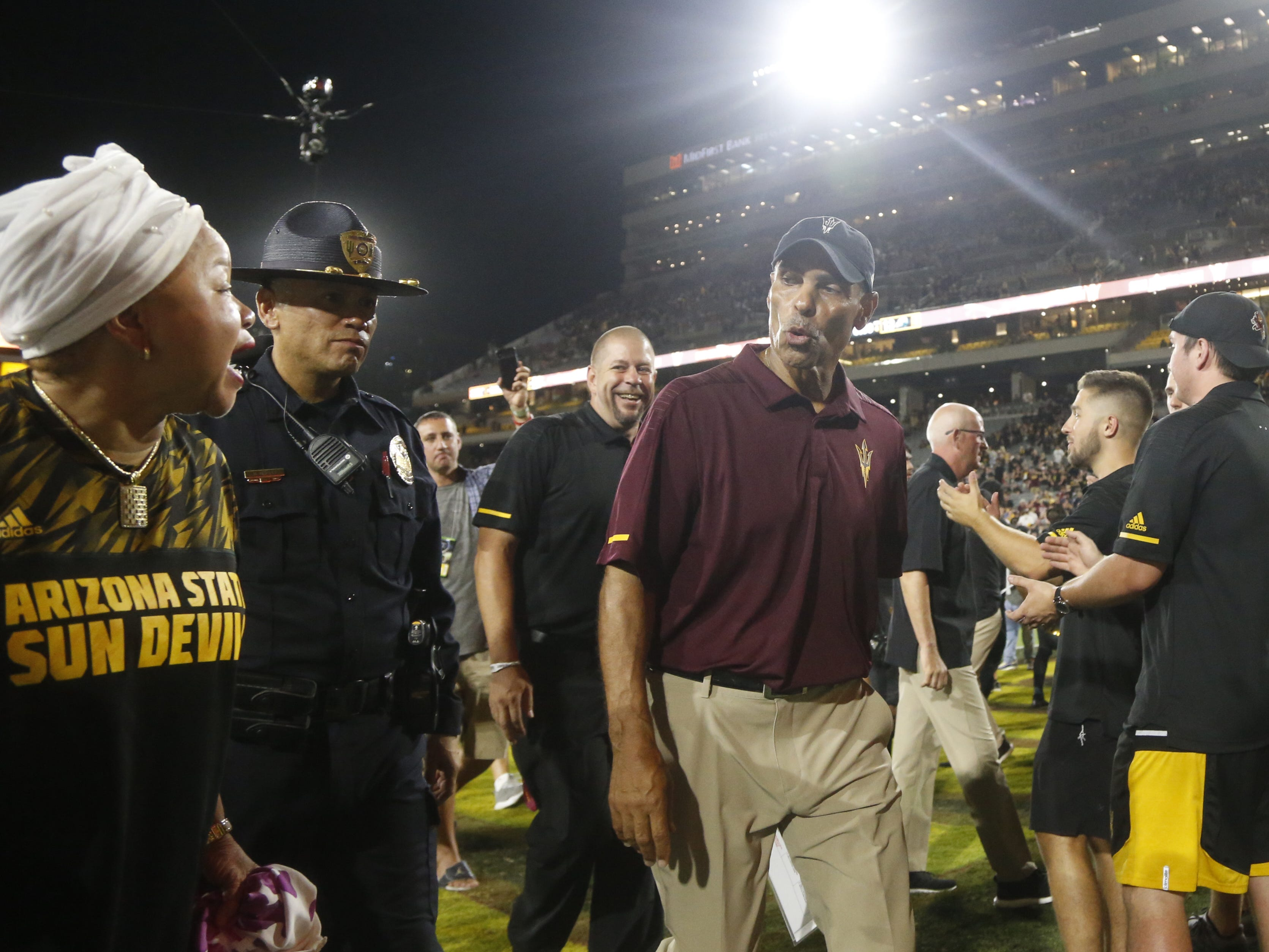 An ASU fan thanks Herm Edwards as he leaves the field after defeating Michigan State 16-13 at Sun Devil Stadium in Tempe, Ariz. on Sept. 8, 2018.