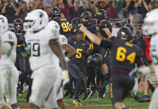 Arizona State rushes the field after winning the game against Michigan State during the second quarter at Sun Devil Stadium in Tempe, Ariz. on Sept. 8, 2018.