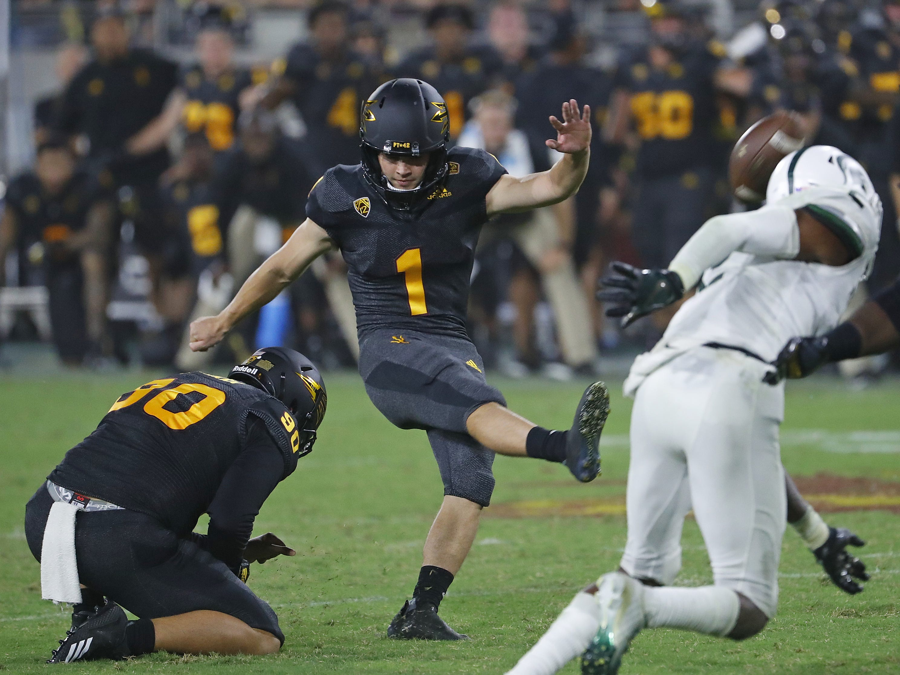 Arizona State Sun Devils place kicker Brandon Ruiz (1) kicks the game-winning field goal as time expires against Michigan State at Sun Devil Stadium in Tempe, Ariz. on Sept. 8, 2018.