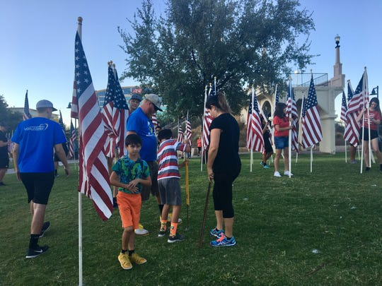 Stephanie Navarro got her family up early on a weekend to volunteer at the Tempe Healing Field last year, each taking turns pounding in rebar for flags for the 9/11 memorial display.