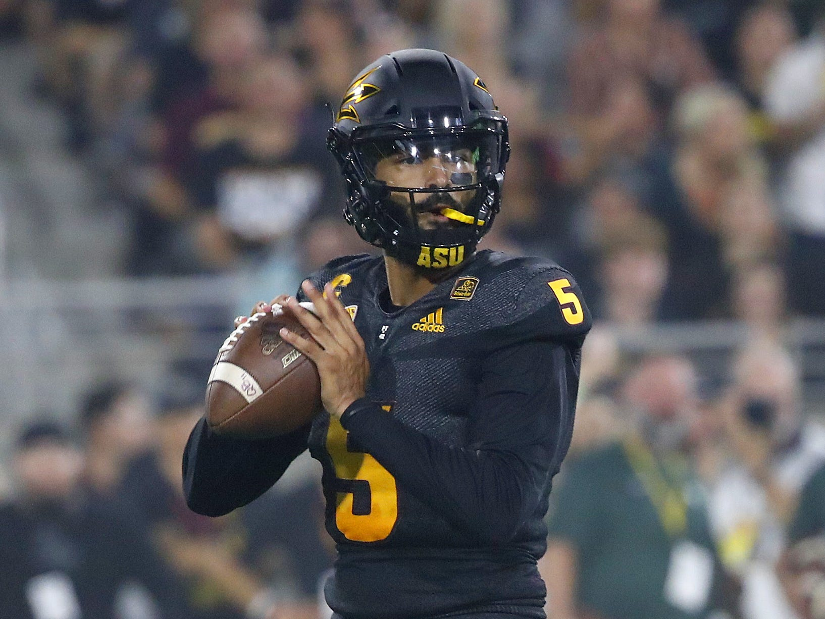 Arizona State Sun Devils quarterback Manny Wilkins (5) looks for receivers against Michigan State during the second quarter at Sun Devil Stadium in Tempe, Ariz. on Sept. 8, 2018.