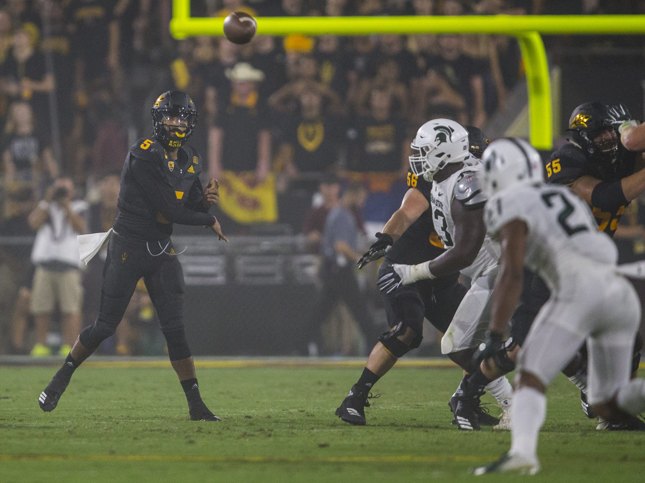 Arizona State's Manny Wilkins throws against Michigan State in the 2nd quarter on Saturday, Sept. 8, 2018, at Sun Devil Stadium in Tempe, Ariz.