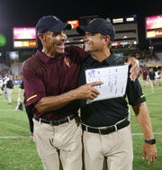 Arizona State head coach Herm Edwards and defensive coordinator Danny Gonzales enjoy the moment after defeating #15 Michigan State 16-13 on Sep. 8, 2018, at Sun Devil Stadium.