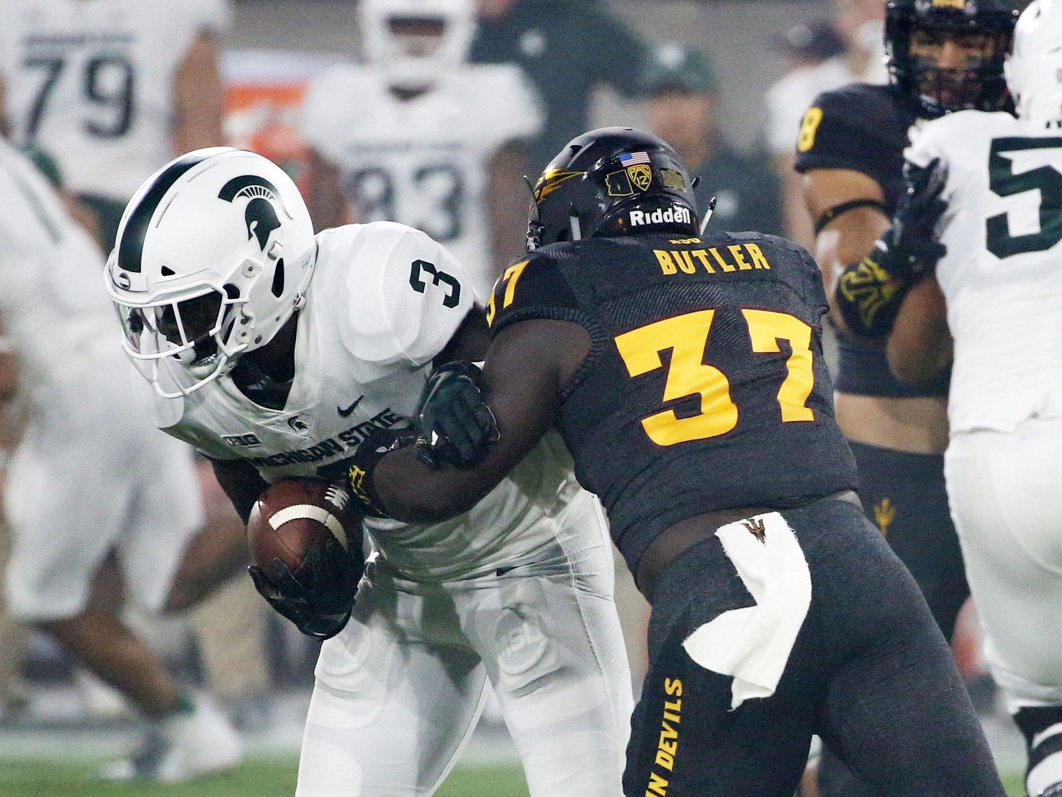 Arizona State linebacker Darien Butler tackles Michigan State running back LJ Scott on Sep. 8, 2018, at Sun Devil Stadium.