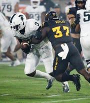 Arizona State linebacker Darien Butler tackles Michigan State running back LJ Scott on Sep. 8, 2018, at Sun Devil Stadium.