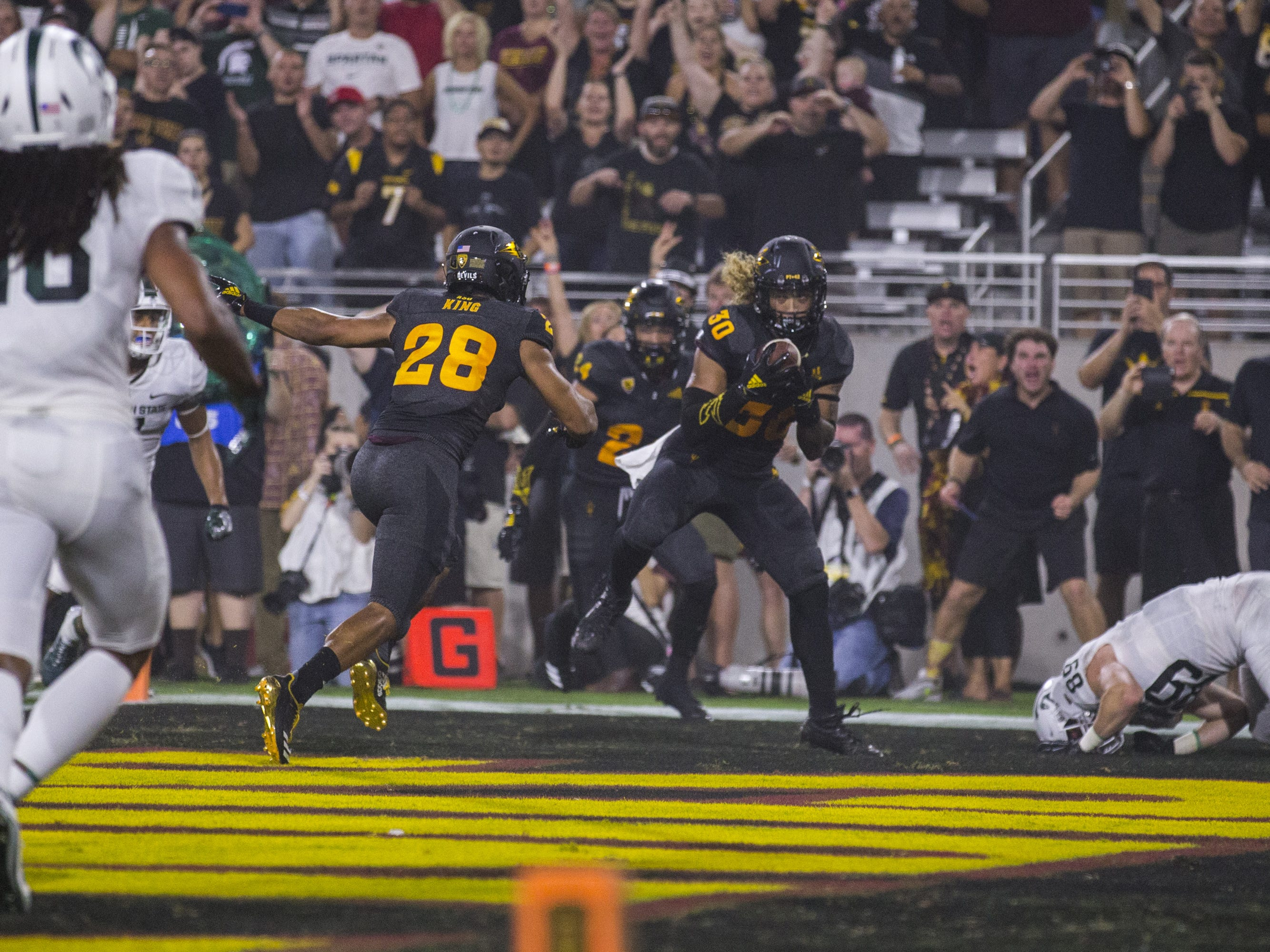 Arizona State's Dasmond Tautalatasi makes an interception the endzone against Michigan State in the 2nd quarter on Saturday, Sept. 8, 2018, at Sun Devil Stadium in Tempe, Ariz.