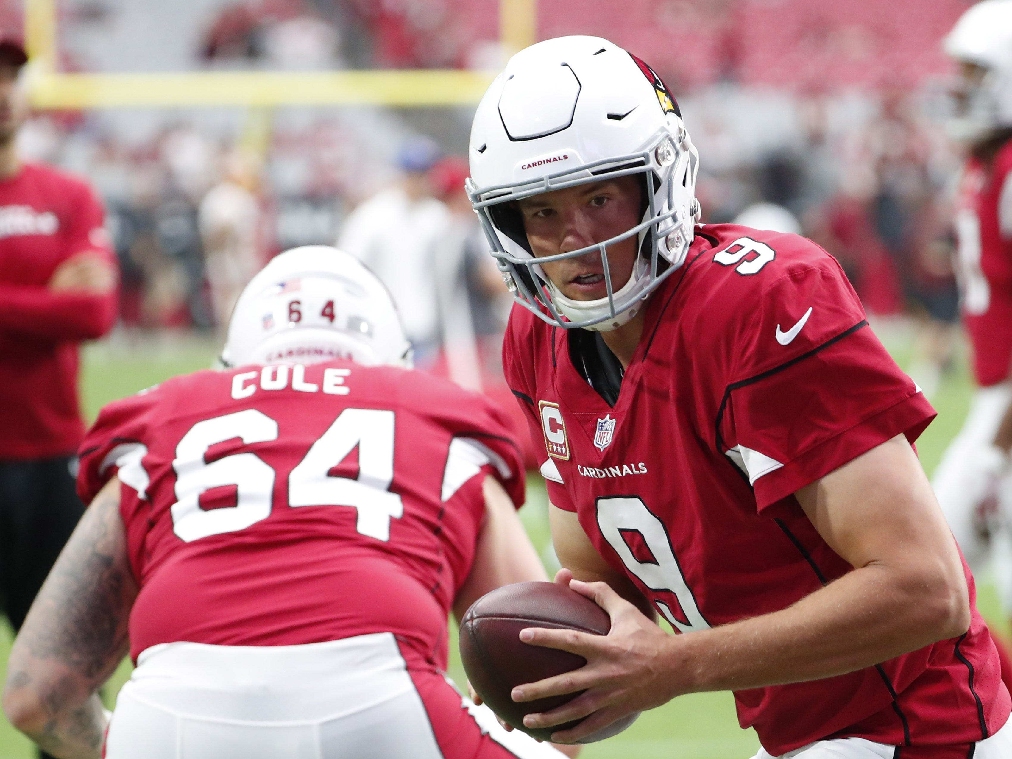 Arizona Cardinals quarterback Sam Bradford (9) warms up before playing against the Washington Redskins at State Farm Stadium in Glendale, Ariz. September 9. 2018.