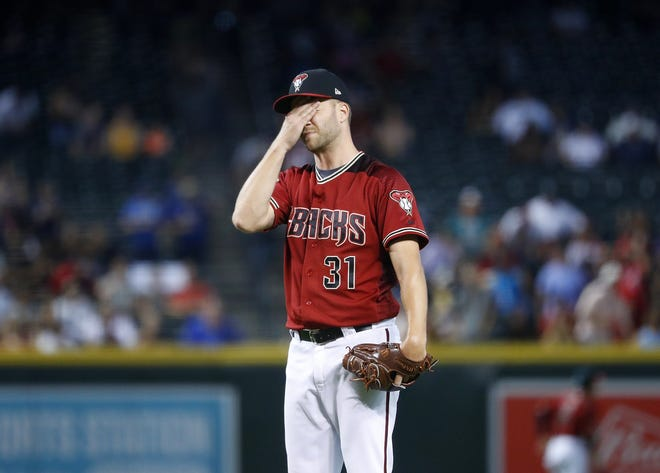 Diamondbacks closer Brad Boxberger (31) reacts after giving up a three-run home run during the ninth inning to the Braves Ender Inciarte at Chase Field in Phoenix, Ariz. on Sept. 9, 2018.