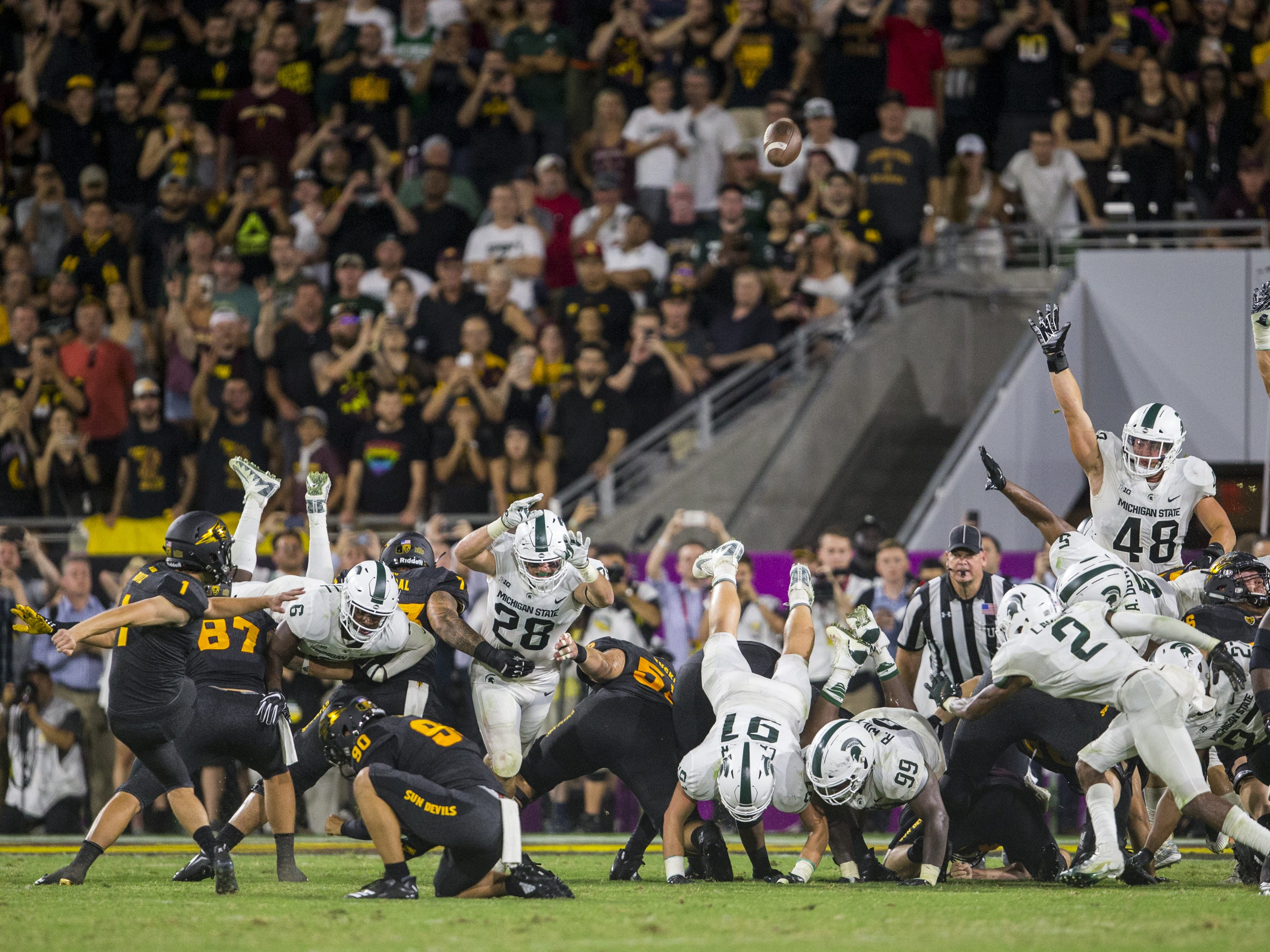 Arizona State's Brandon Ruiz kicks the game-winning field goal against Michigan State in the 4th quarter on Saturday, Sept. 8, 2018, at Sun Devil Stadium in Tempe, Ariz. Arizona State won, 16-13.