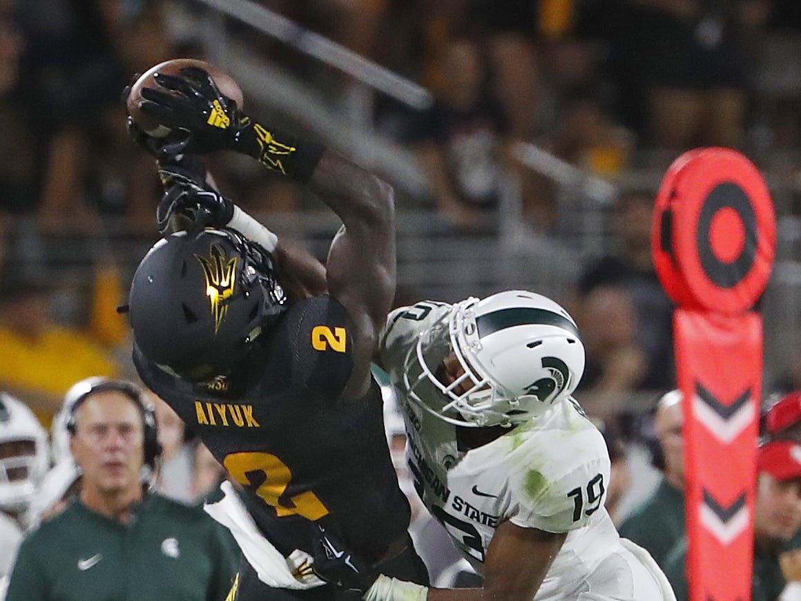Arizona State Sun Devils wide receiver Brandon Aiyuk (2) makes a catch against Michigan State's Josh Butler (19) but lands out of bounds during the fourth quarter at Sun Devil Stadium in Tempe, Ariz. on Sept. 8, 2018.