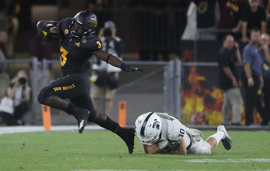 Arizona State Sun Devils running back Eno Benjamin (3) breaks a tackle from Michigan State's Matt Morrissey (10) during the fourth quarter at Sun Devil Stadium in Tempe, Ariz. on Sept. 8, 2018.