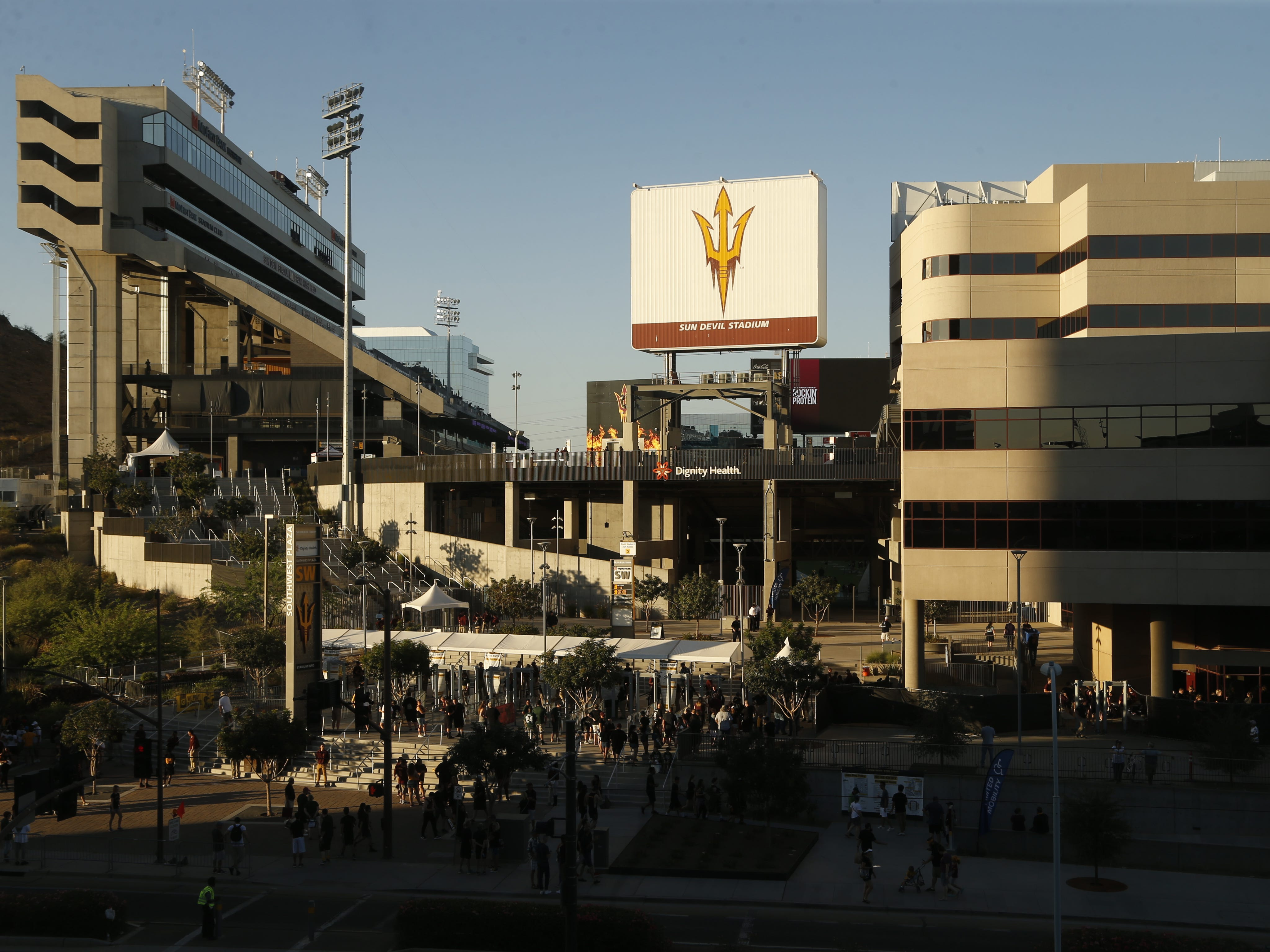 Fans arrive as the sun sets before an ASU game against Michigan State at Sun Devil Stadium in Tempe, Ariz. on Sept. 8, 2018.
