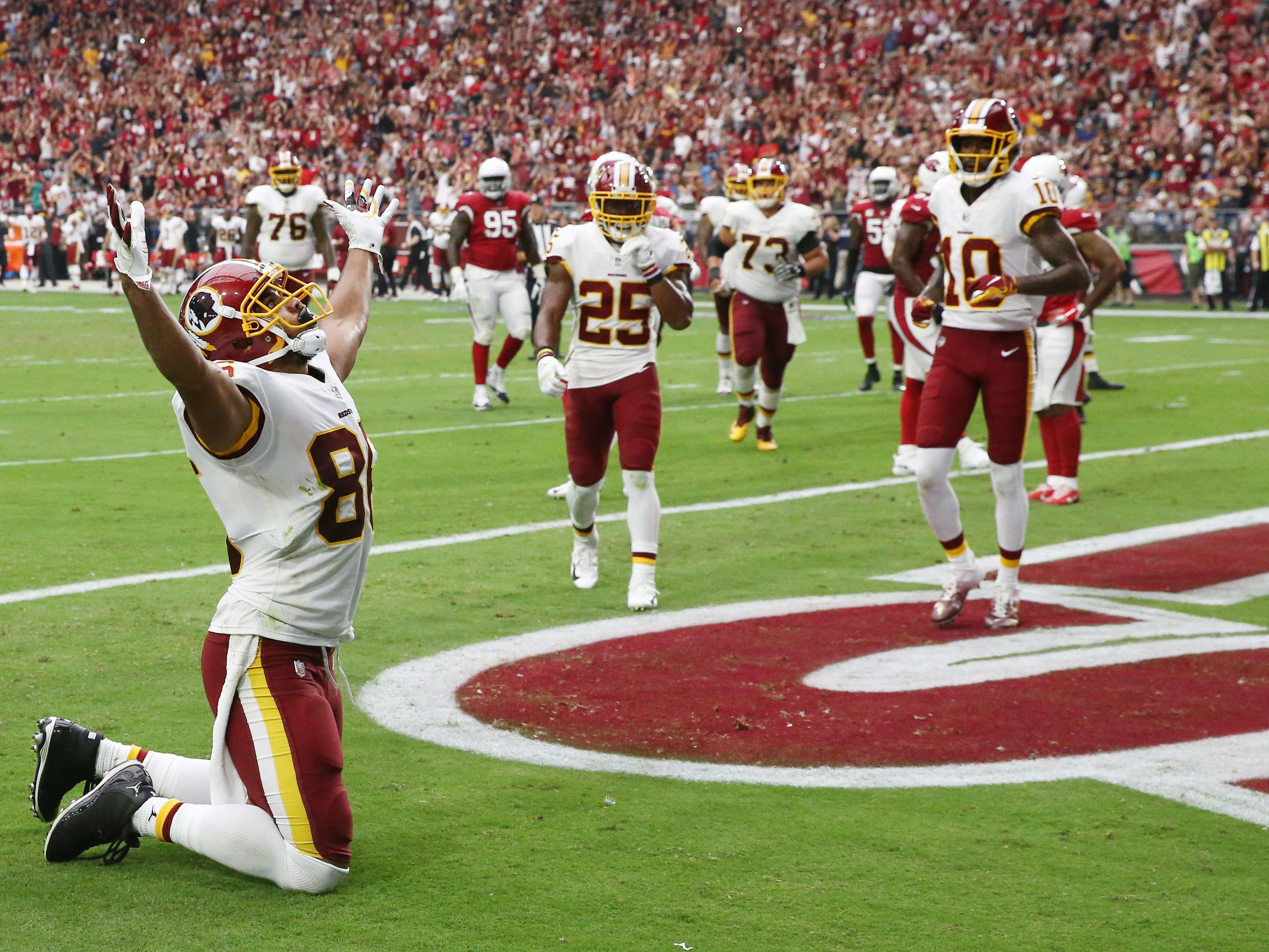 Washington Redskins tight end Jordan Reed celebrates his touchdown catch against the Arizona Cardinals in the first half at State Farm Stadium.
