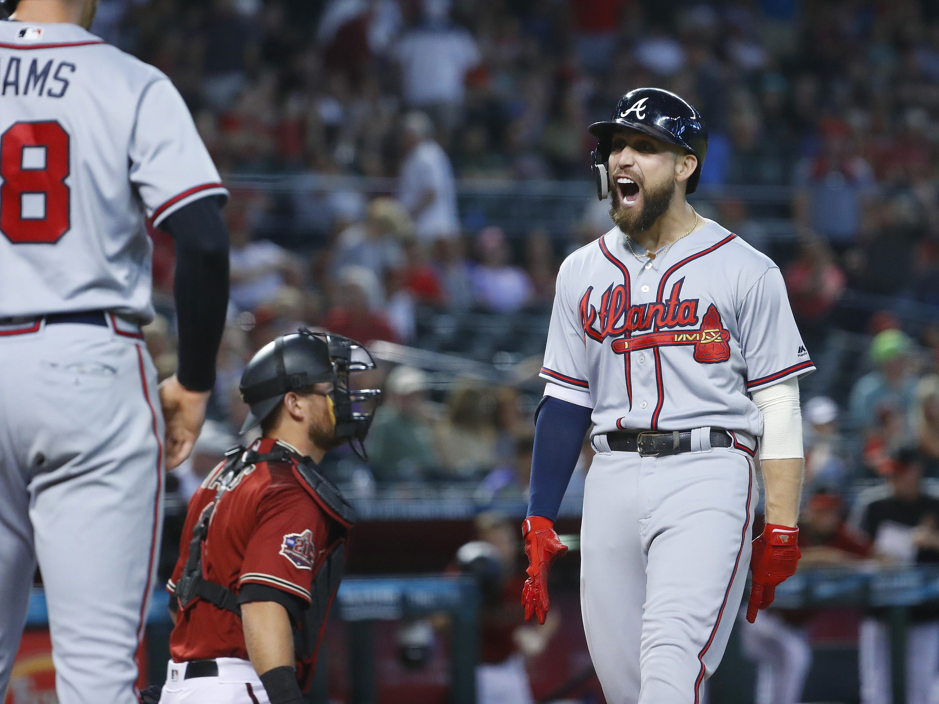 Braves Ender Inciarte (11) celebrates on his way home after hitting a three-run home run during the ninth inning at Chase Field in Phoenix, Ariz. on Sept. 9, 2018.