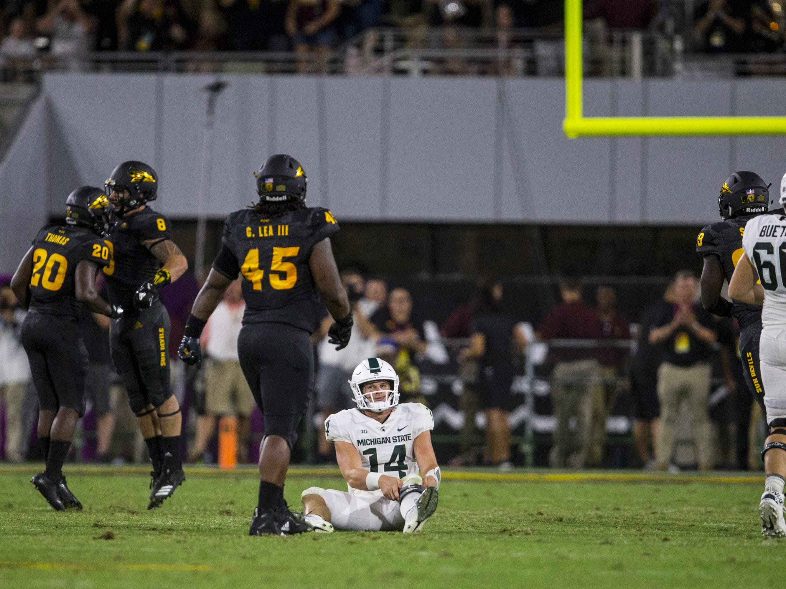 Michigan State's Brian Lewerke lies on the ground after being sacked against Arizona State in the 4th quarter on Saturday, Sept. 8, 2018, at Sun Devil Stadium in Tempe, Ariz. Arizona State won, 16-13.