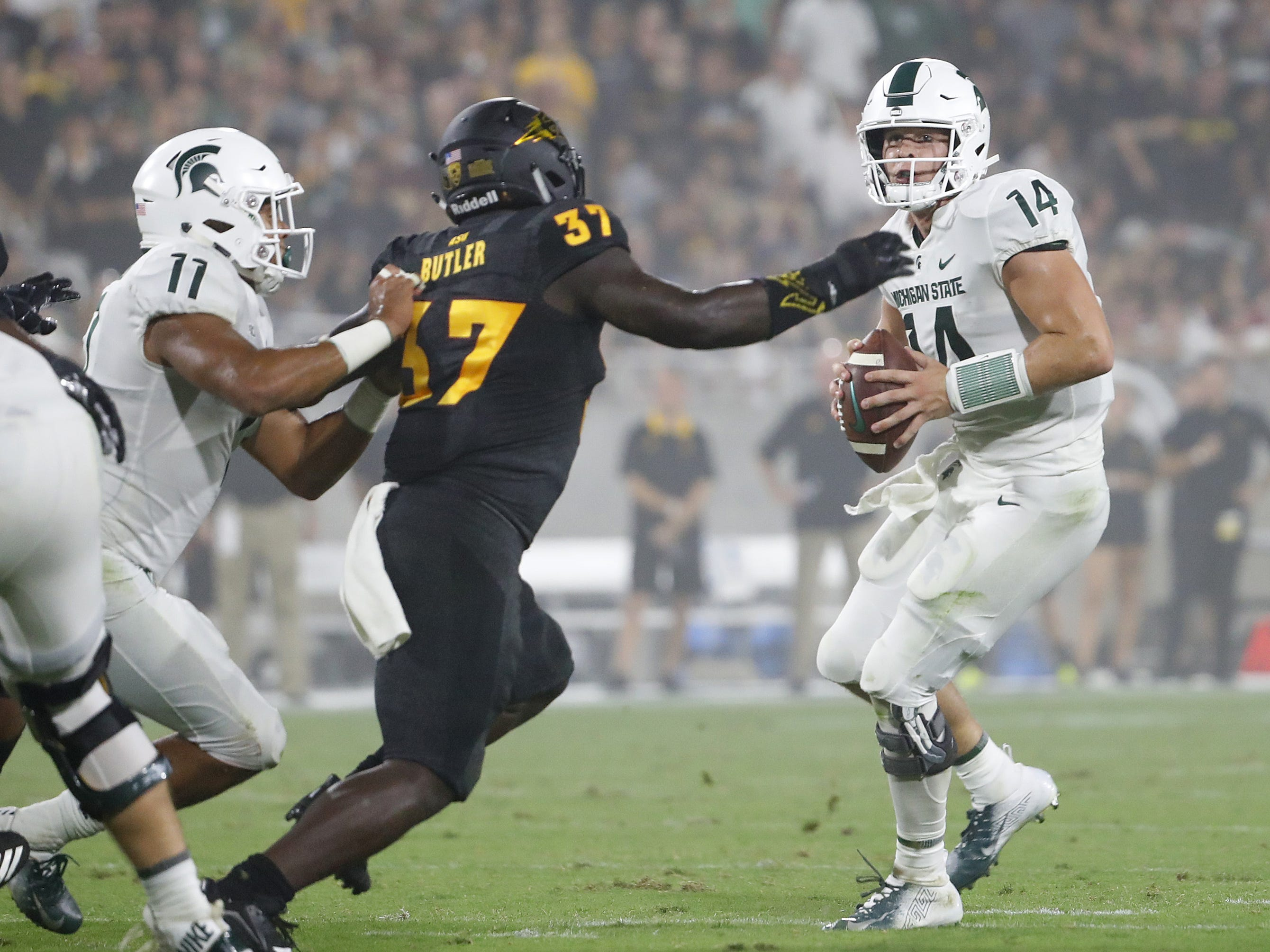 Arizona State Sun Devils defensive back Darien Butler (37) forces a throw from Michigan State's Brian Lewerke (14) resulting in an interception during the second quarter at Sun Devil Stadium in Tempe, Ariz. on Sept. 8, 2018.
