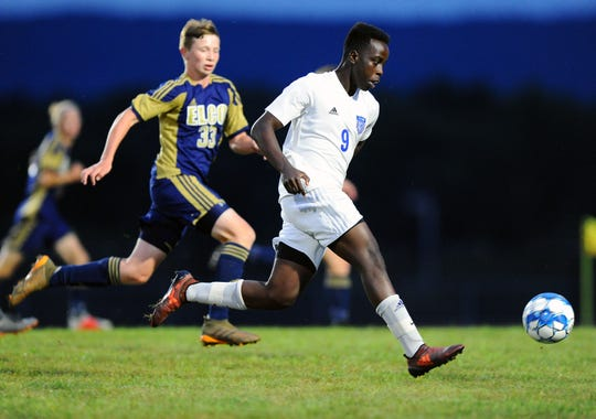 Will Malawi (9) of Cedar Crest out races Elco defender Jaydon Grumbine (33) to the ball during first half action Saturday Sept.8,2018 at Elco High School.
