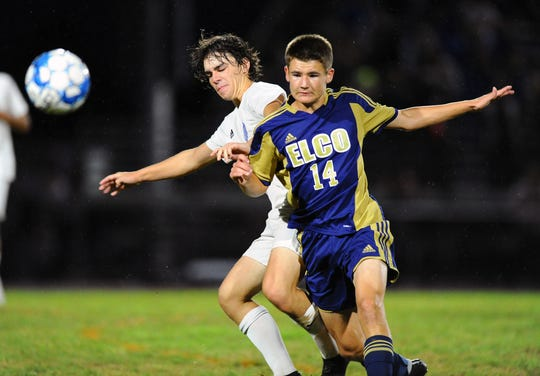 Ethan Wenzler (11) from Cedar Crest and Riley Blatt (14) from Elco battle for this ball along the sideline during first half action Saturday Sept. 8, 2018 at Elco High School.