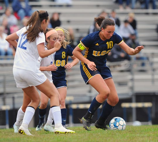 Ryelle Shuey (10) of Elco gets control of the ball at midfield over Cedar Crest defender Reese Glover (12) during 1st.half action Saturday Sept.8, 2018 at Elco High School.