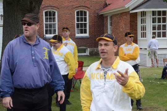 """Front from left, Lapeer Tigers team captain Jeff """"Peewee"""" Haas and Richmond Bees team captain Mike """"Catfish"""" Sopoliga talk to their team members before a vintage baseball game at the Fort Gratiot Hospital Heritage Days on Sept. 9, 2018."""