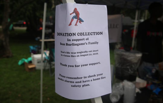 A sign promotes the donation collection for the Burlingame family on Sunday in Messier Park during the Wappingers farmers market. The event was hosted by parents of students at Myers Corner Elementary School.