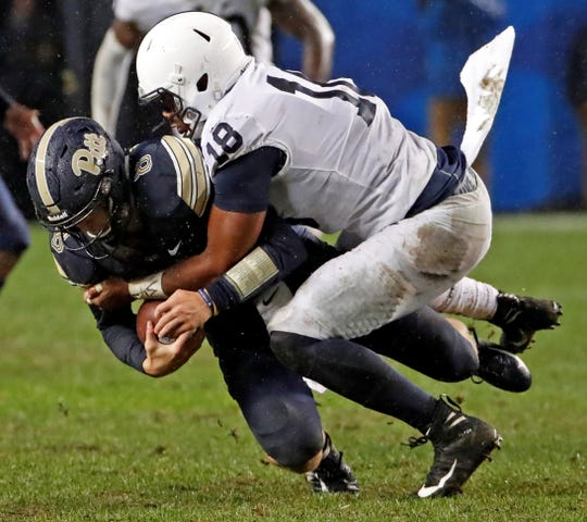 Shaka Toney, seen here sacking Pitt quarterback Shaka Toney, is part of a Penn State defensive line that excelled late in the season. AP FILE PHOTO