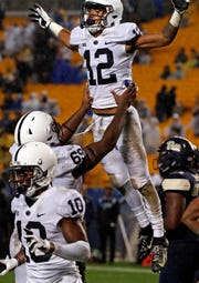 Penn State wide receiver Mac Hippenhammer (12) celebrates with offensive lineman C.J. Thorpe (69) after scoring a touchdown during the second half of an NCAA college football game against Pittsburgh in Pittsburgh, Saturday, Sept. 8, 2018. Penn State won 51-6. (AP Photo/Gene J. Puskar)